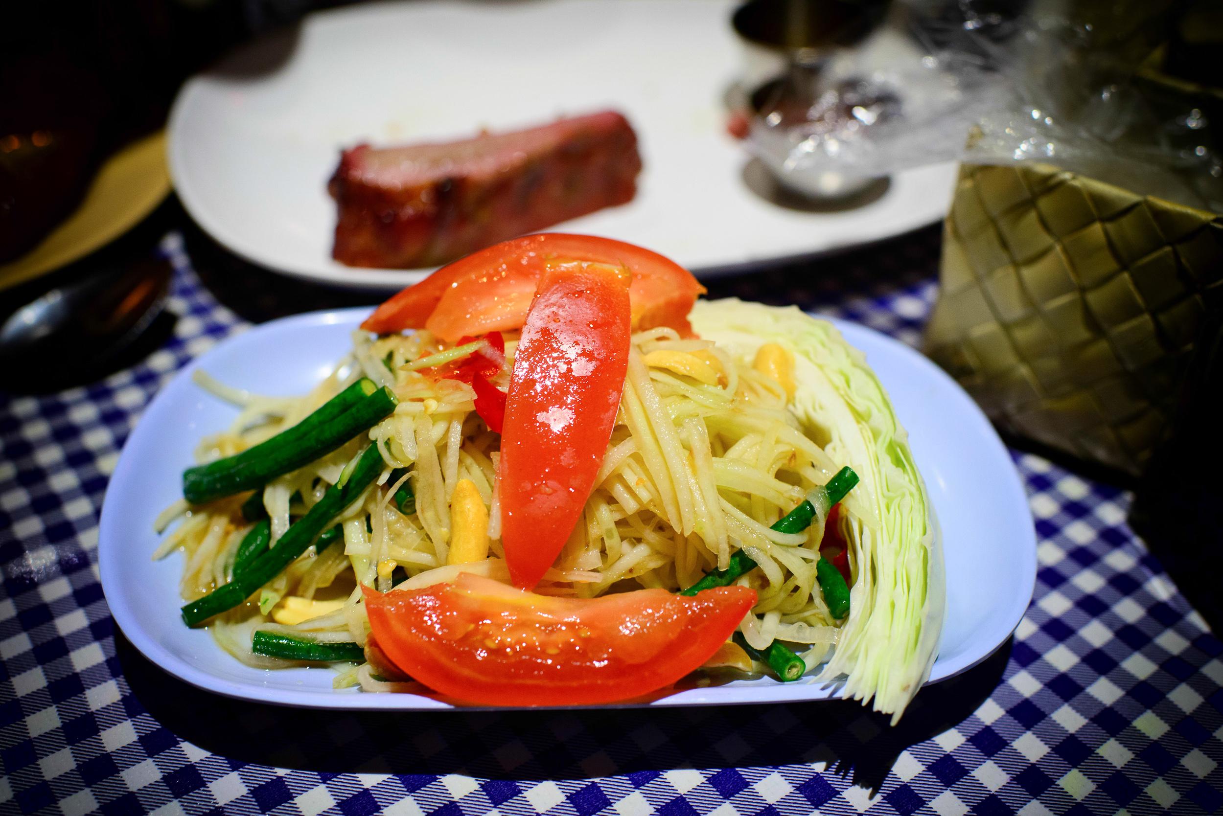 Papaya Pok Pok - Spicy green papaya salad with tomatoes, long be