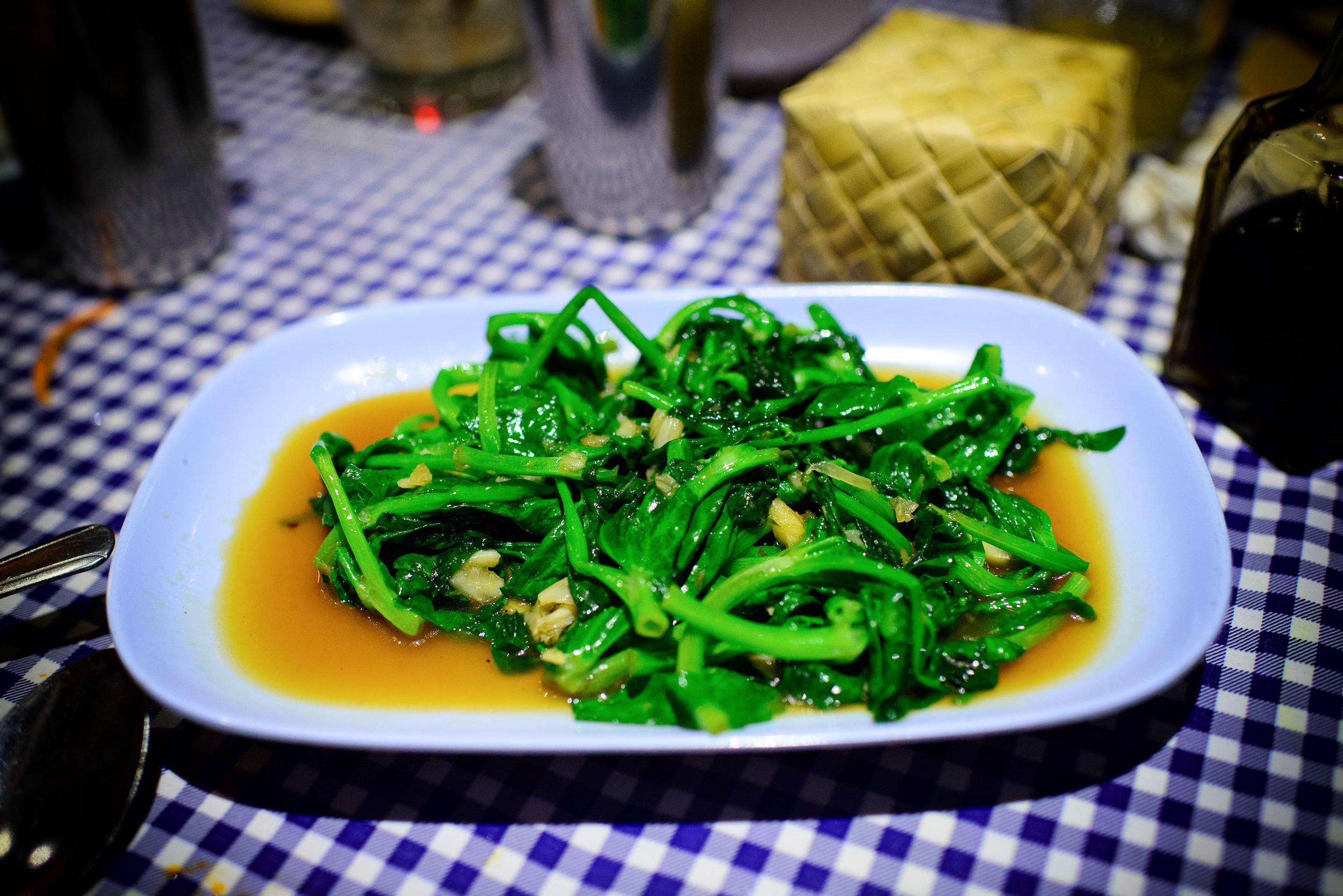Phat Yawt Thua Lan Tao - Pea greens, stir-fried with garlic, fis