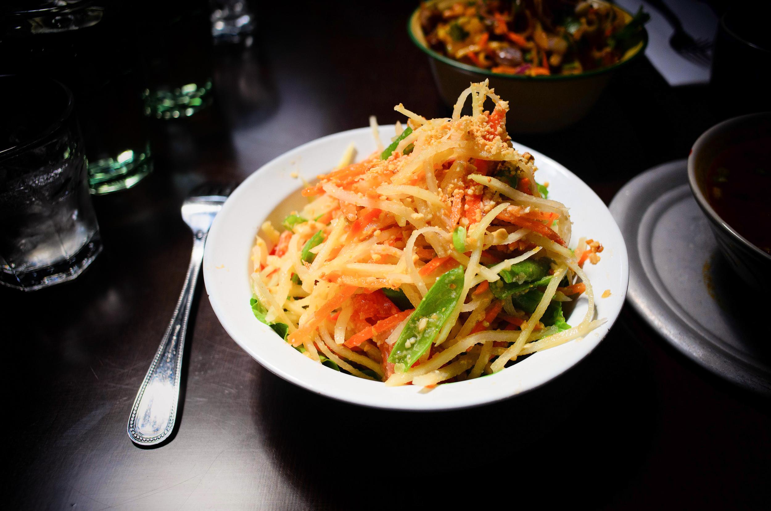 Green papaya salad: tomatoes, string beans, roasted peanuts in c