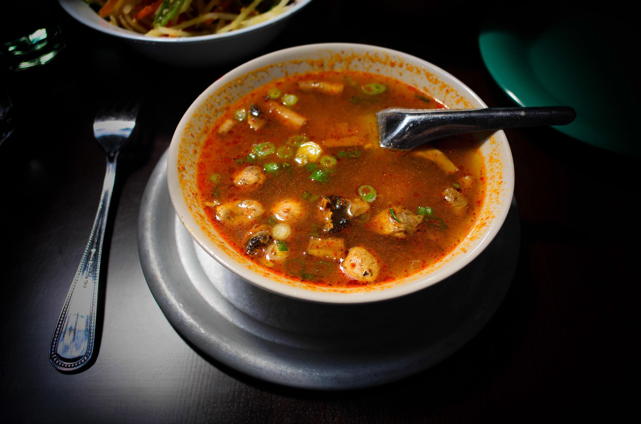 Tom yum (lemongrass) soup: savory sour soup w/ mushrooms, tradit