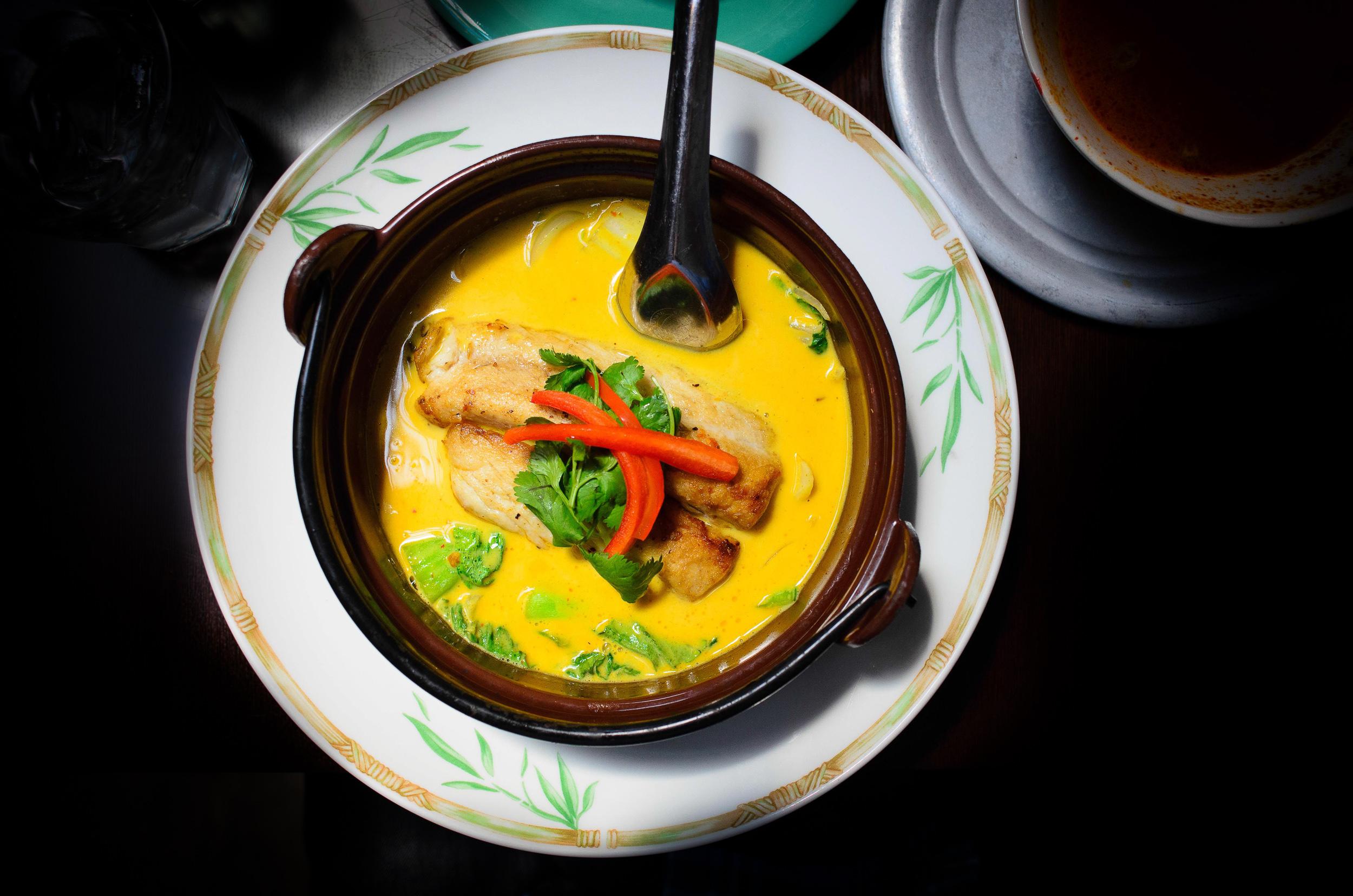 "Kingfish ""teh-pho"" curry in clay pot: bok coy, onions, napa cabb"