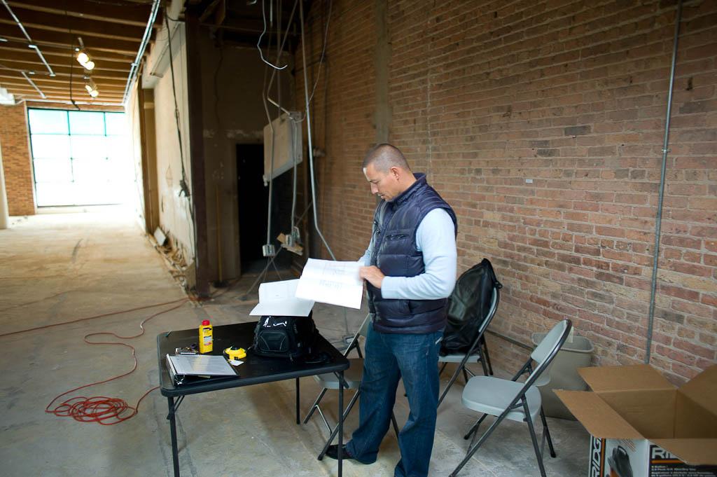 Chef Curtis Duffy looking through floorplans