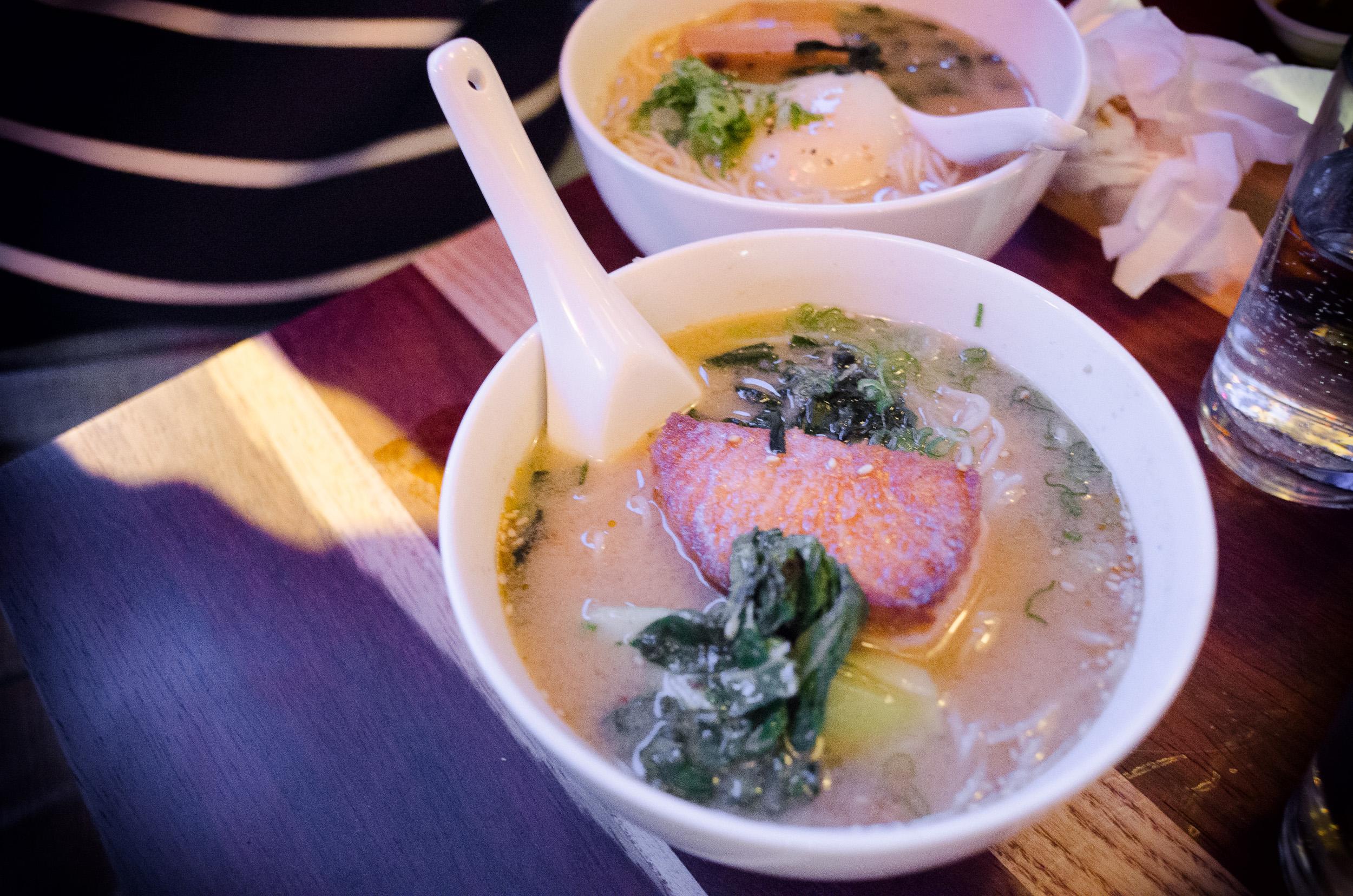 Roasted salmon ramen, spicy miso dashi, scallion, wakame ($13)