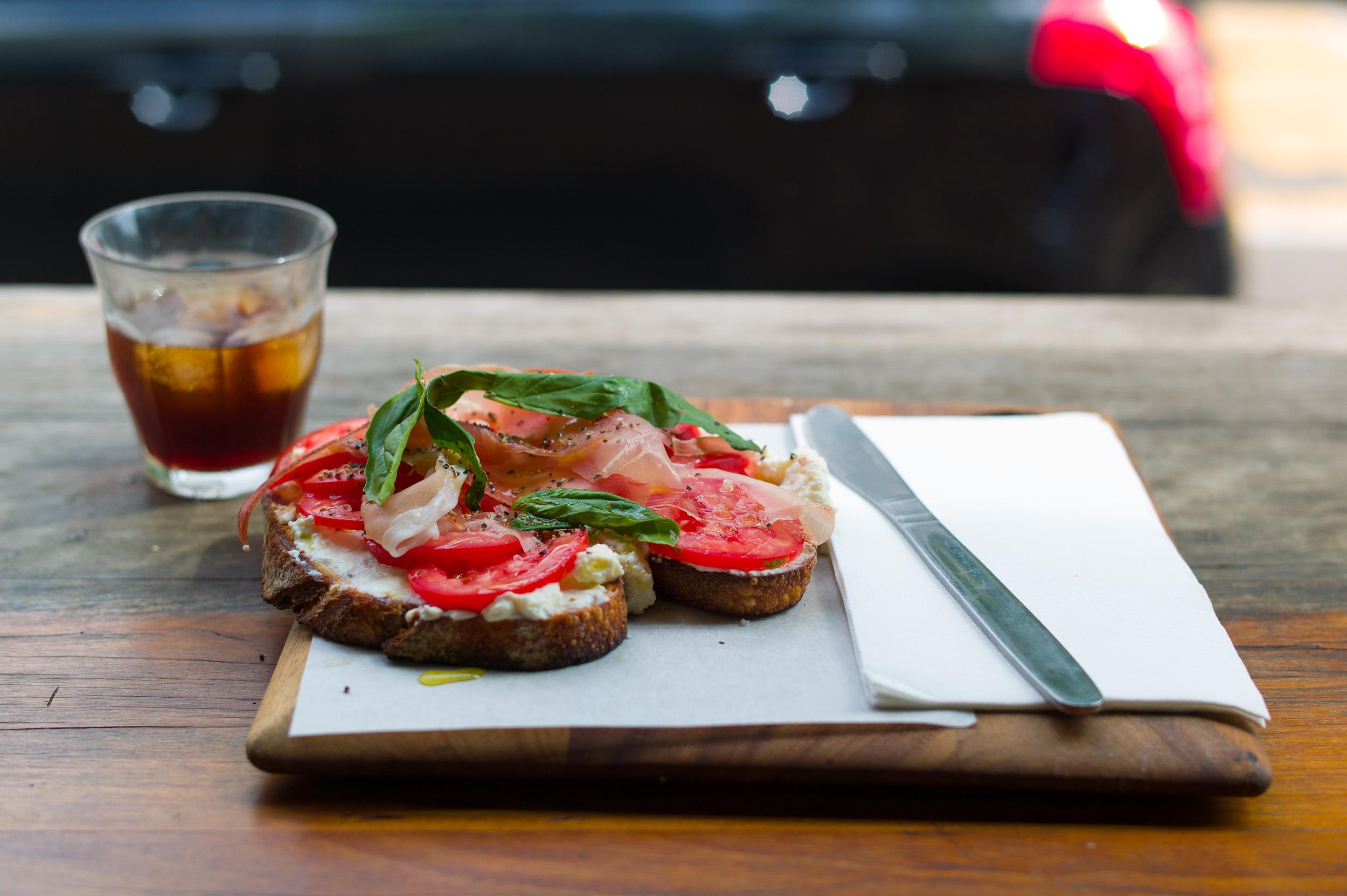 Bruschetta of tomato and ricotta, fresh basil, garlic, thyme-inf