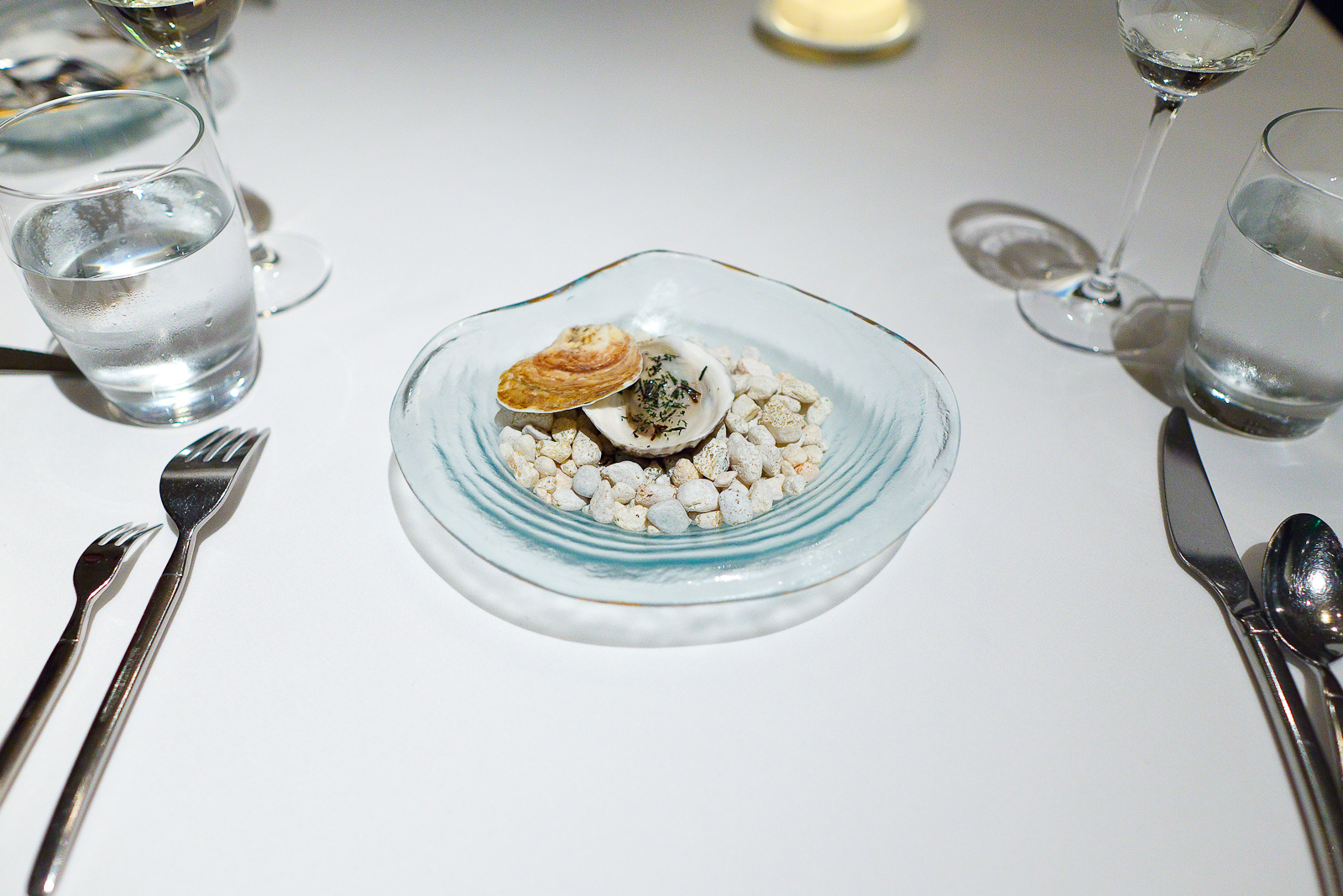 """3rd Course: """"An elemental oyster"""" - Lightly poached in its own shell, ocean water gelée, nori flakes"""