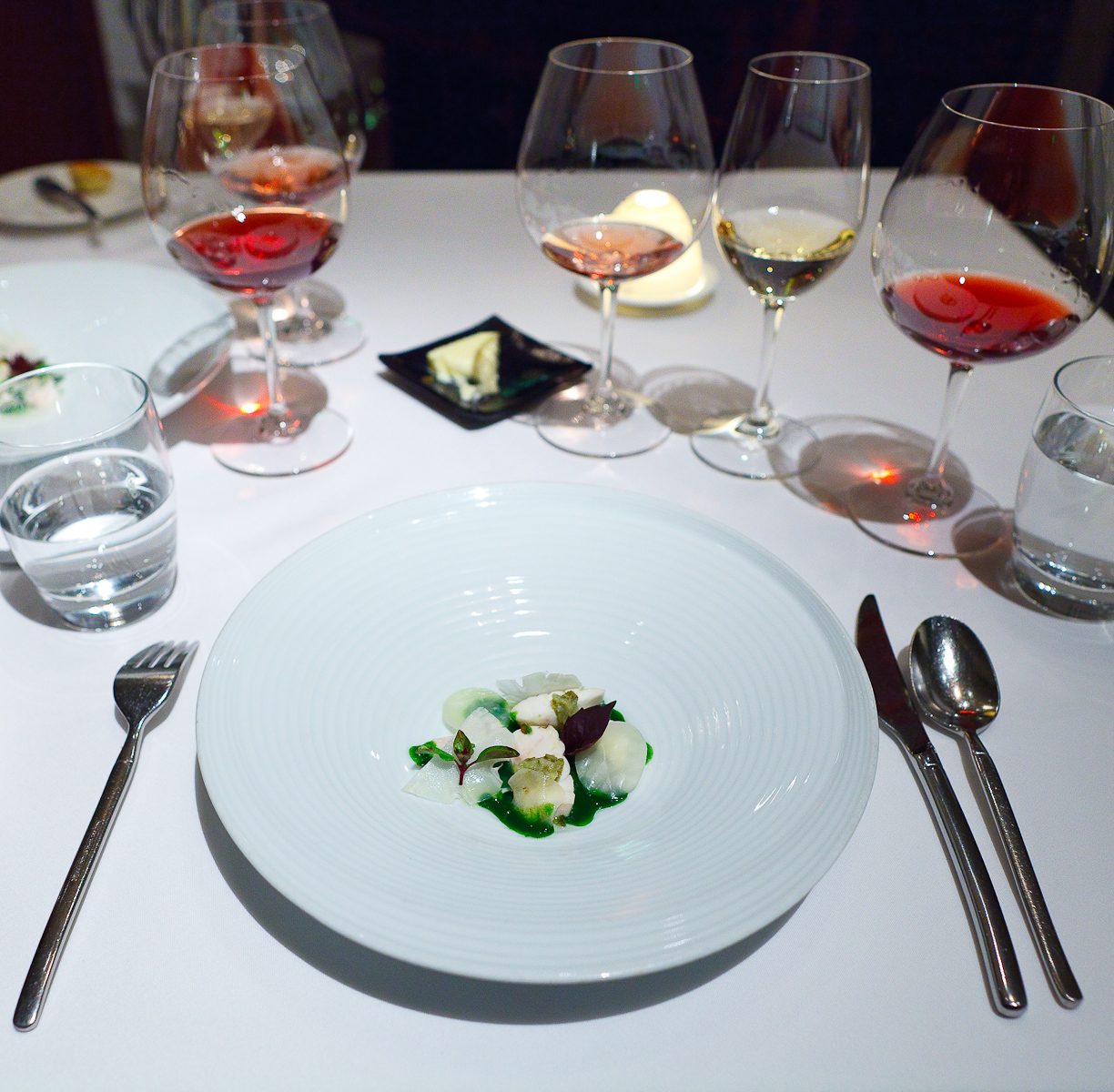 13th Course: Poached halibut served with with young celeriac, romanesco