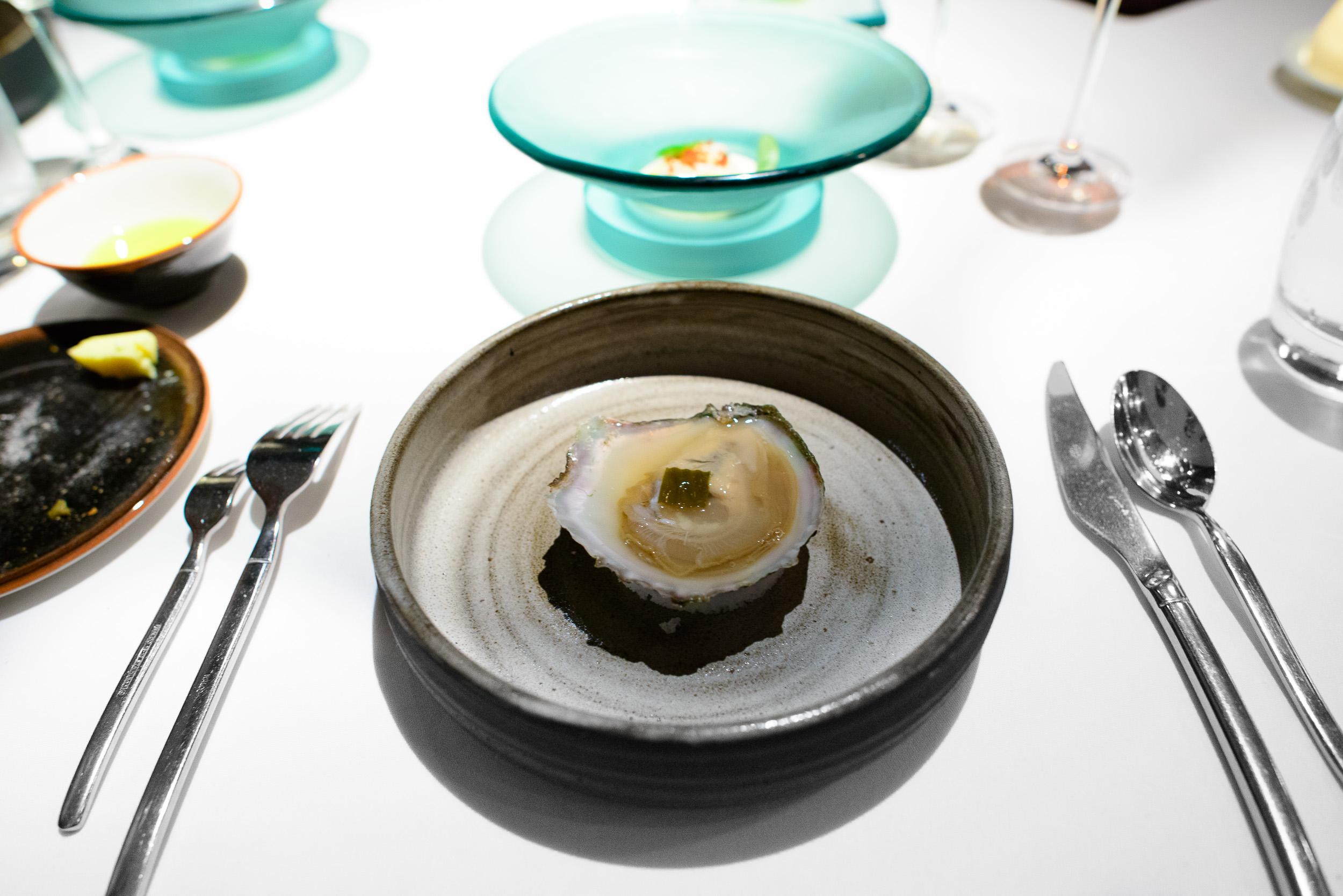 11th Course: Oyster, distilled sake, marinated algae