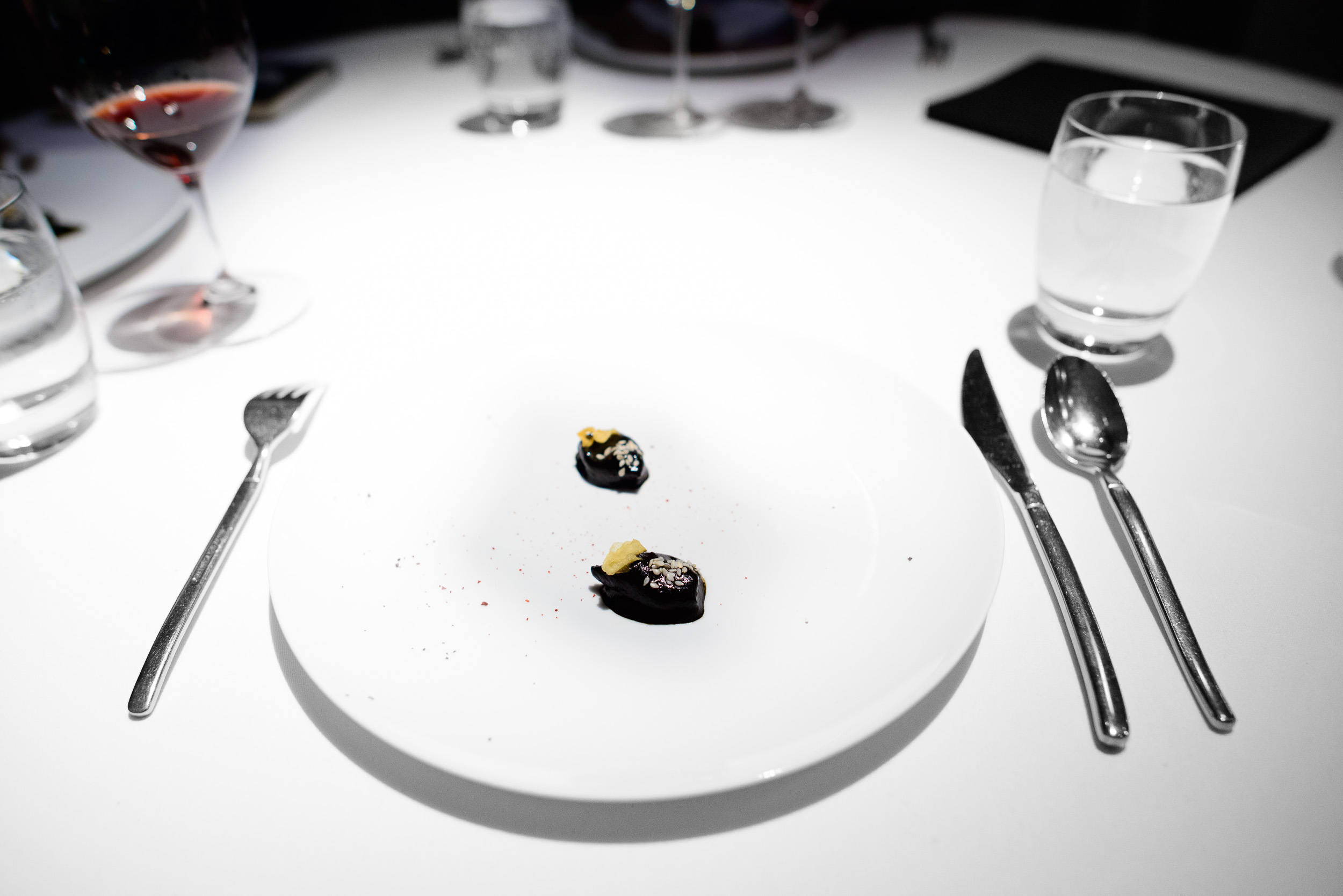 17th Course: Chipirones cooked in their ink, ancho chile, sesame