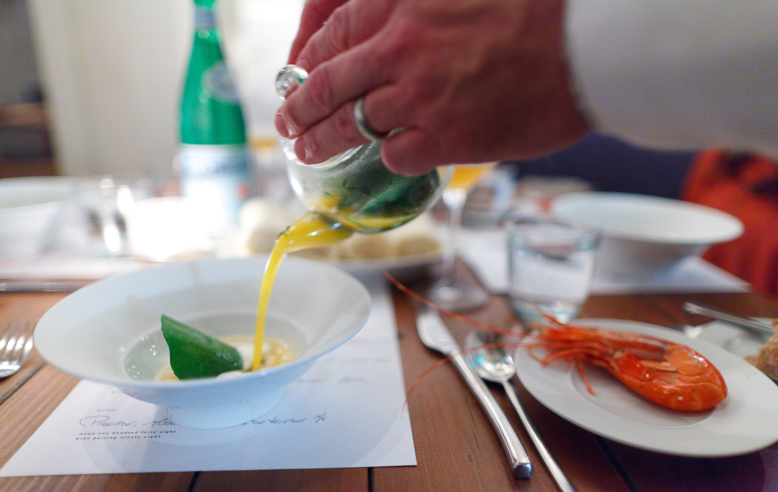 4th Course: Crustacean - Dungeness ragôut gently warmed in crustacean butter. Santa barbara sea urchin, wild nasturtium leaf roasted over the fire until crisp. Crustacean bouillion of lobste
