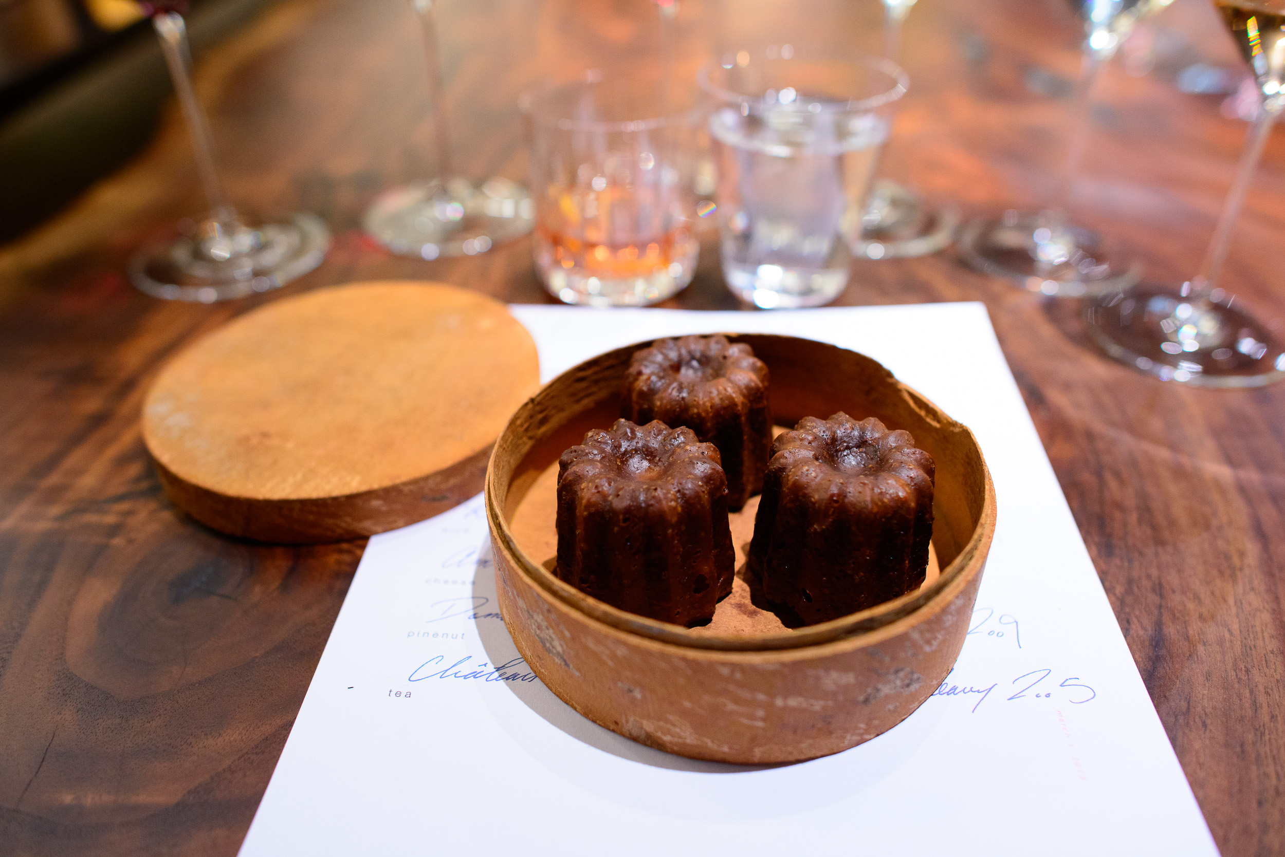 """21st Course: Canelés roasted in """"the beast"""" (Saison's wood-burn"""