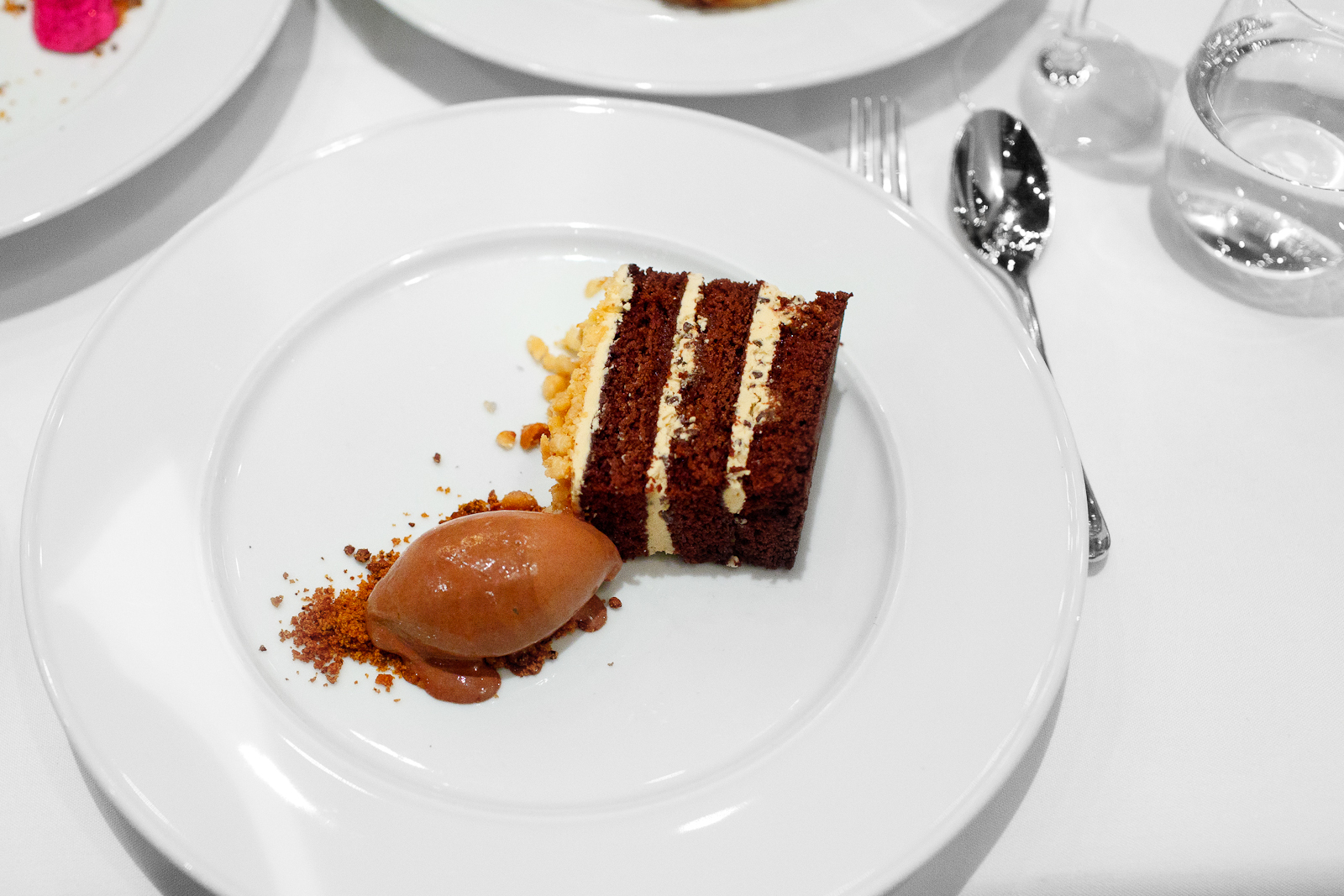 8th Course: Torta de cioccolato - chocolate cake, passionfruit caramel buttercream, macadamia, dark chocolate gelato