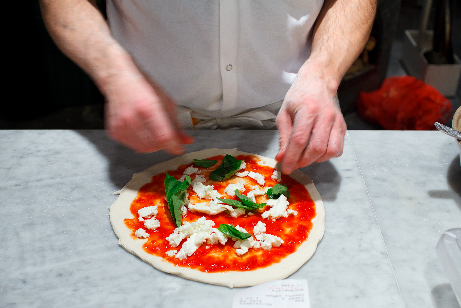 Making a pizza margherita