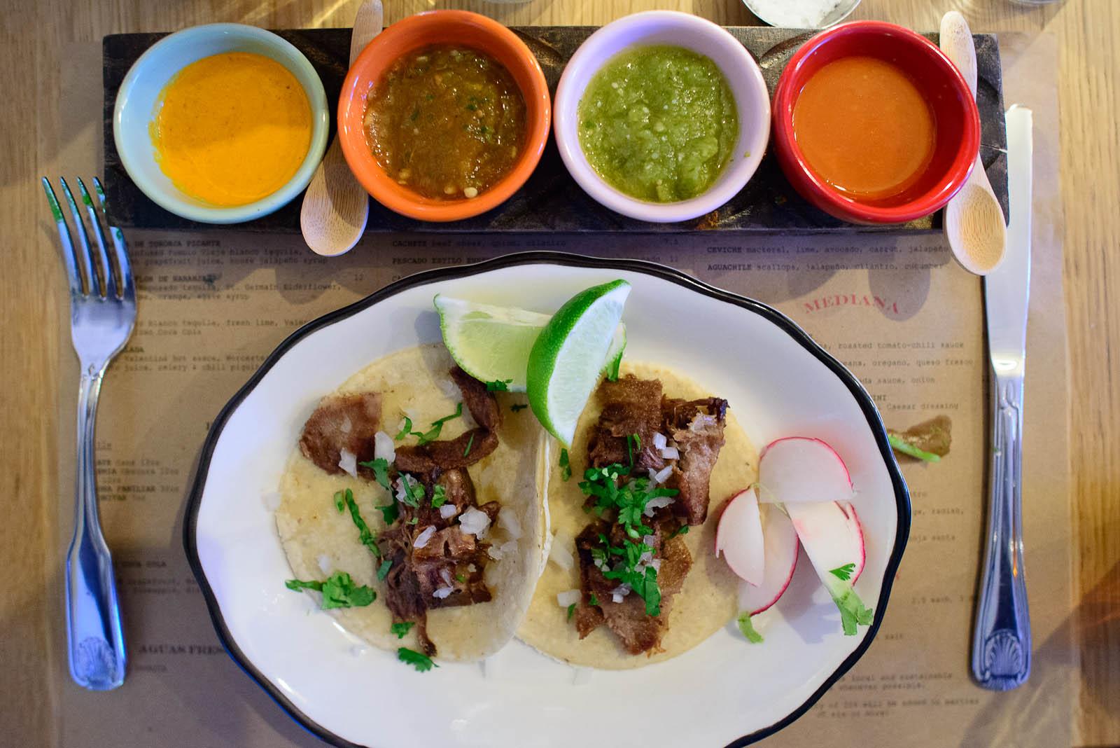 Tacos de lengua (tongue), onion, cilantro, radish with salsas (s