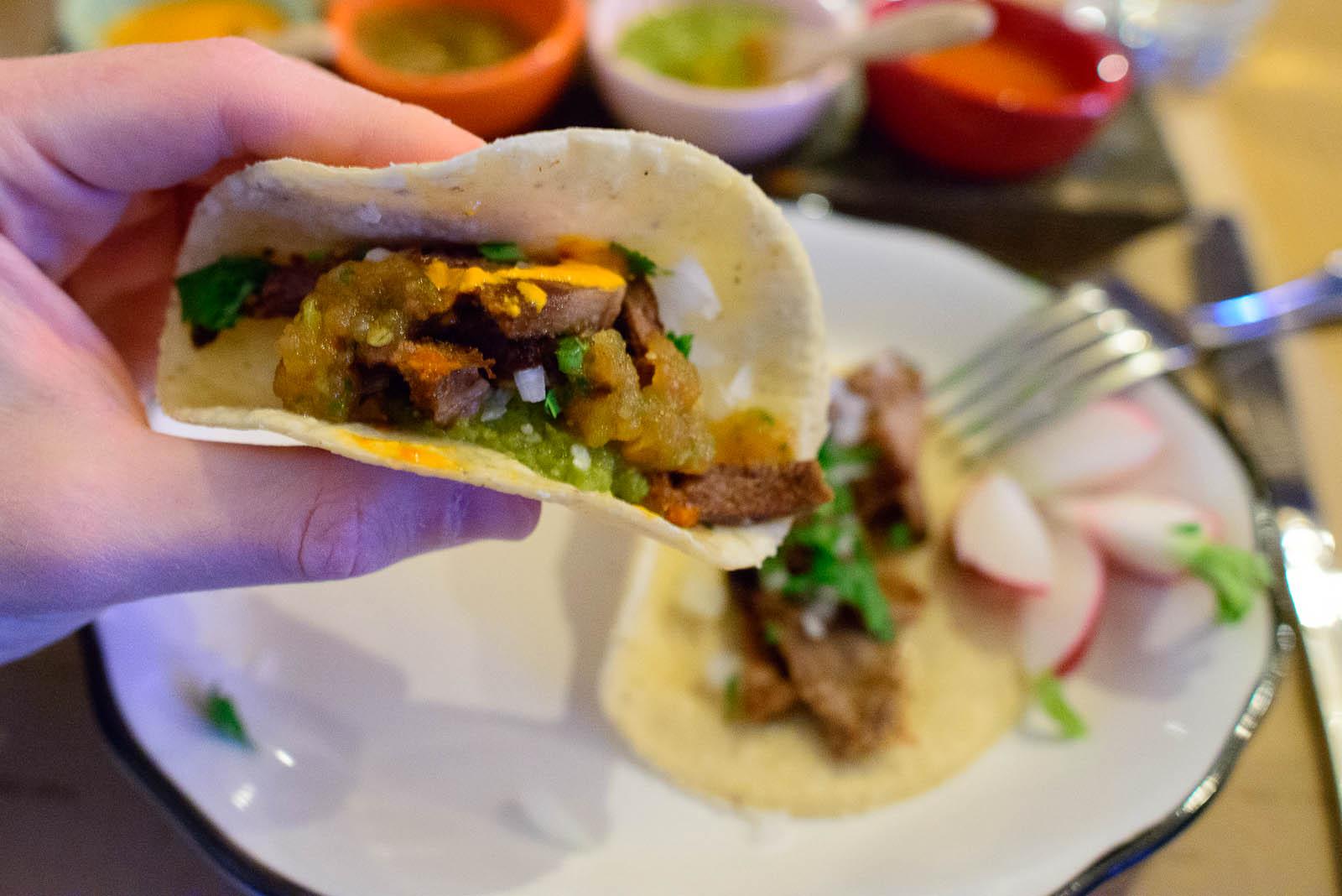 Taco de lengua (tongue), onion, cilantro, radish with salsas (se
