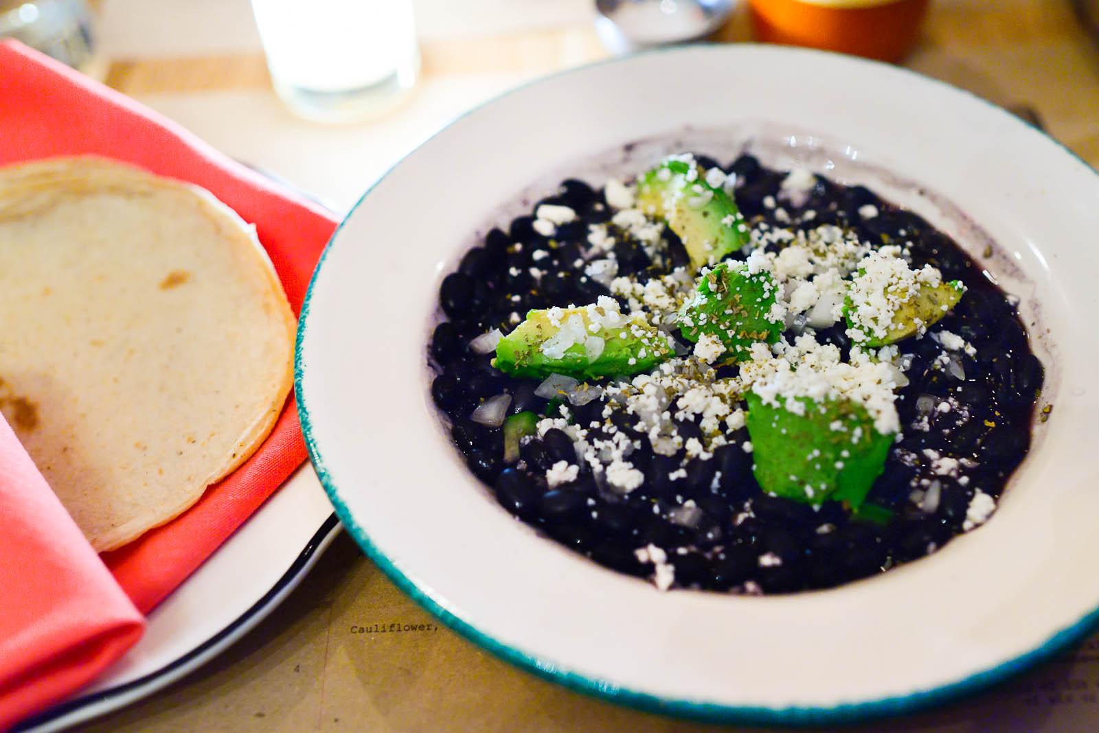 Frijoles de la olla - black beans, oregano, queso fresco ($9)