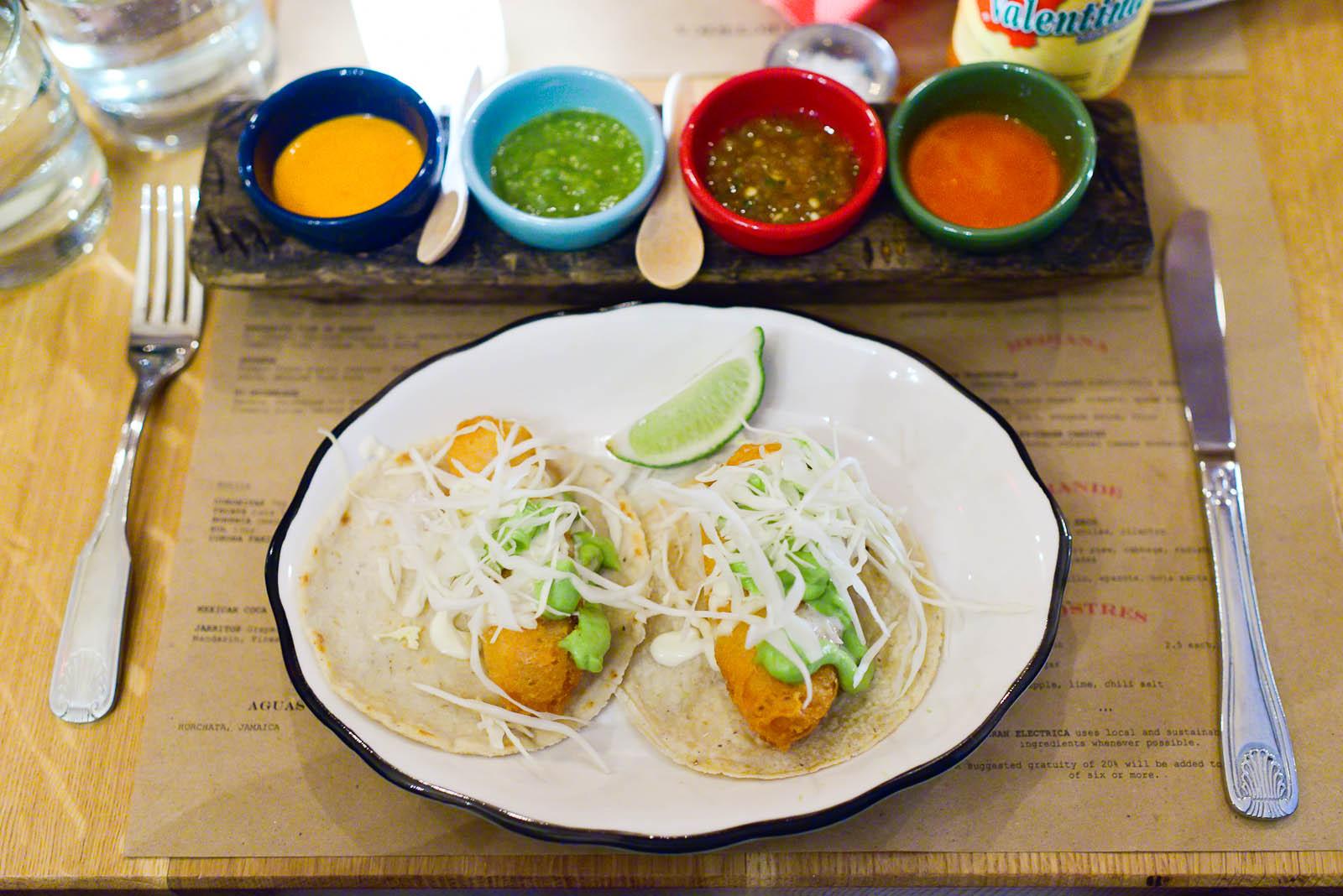 Tacos de pescado estilo ensenada - striped bass, cabbage, avocad