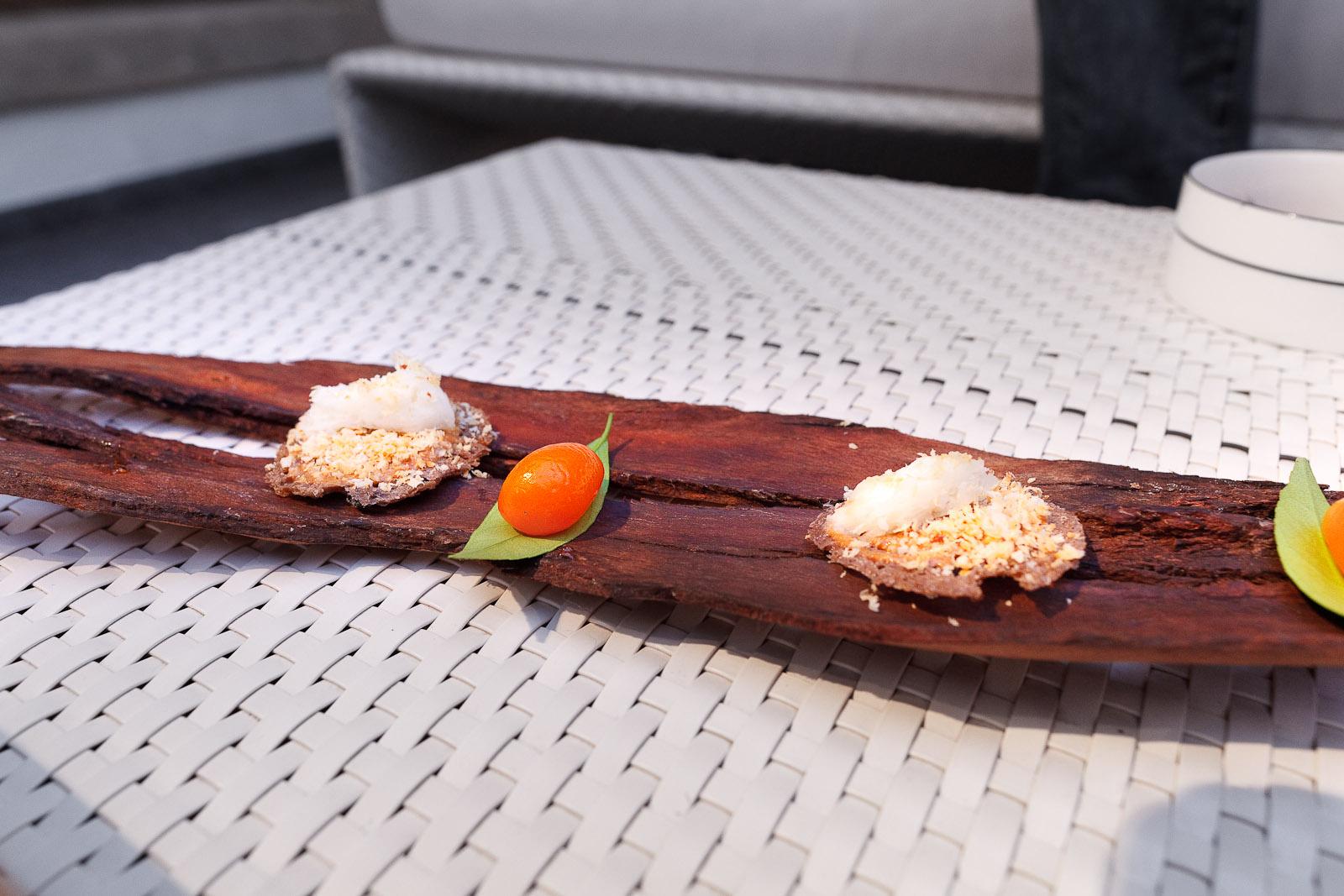 Amuse bouche: Kumquat filled with flying fish eggs