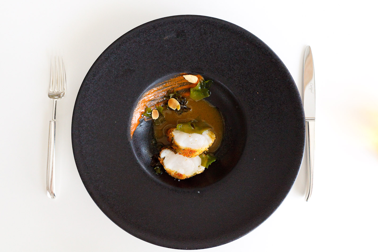 15th Course: Breaded monkfish in seaweed sauce, almonds.