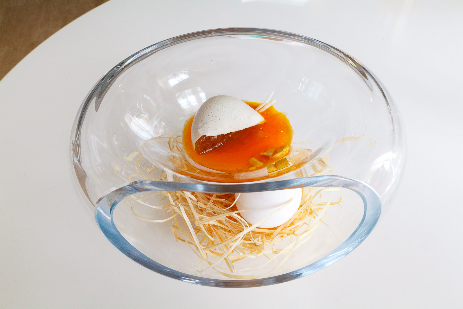 """18th Course: """"Which came first?"""" - Chicken stock and egg yolk poured out when sliced."""