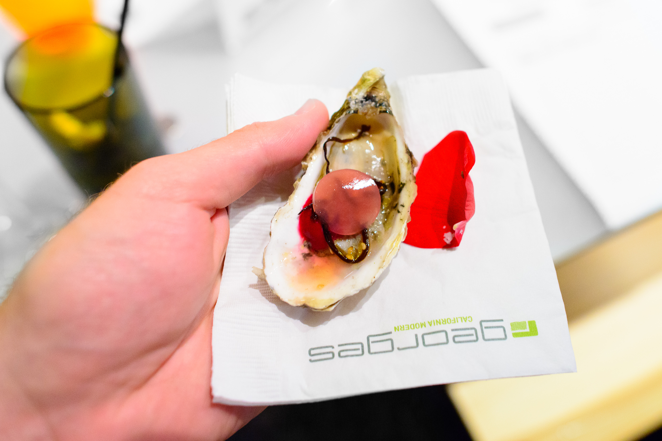 Snack 1: Oyster, rose, smoked beet. By Trey Foshee.