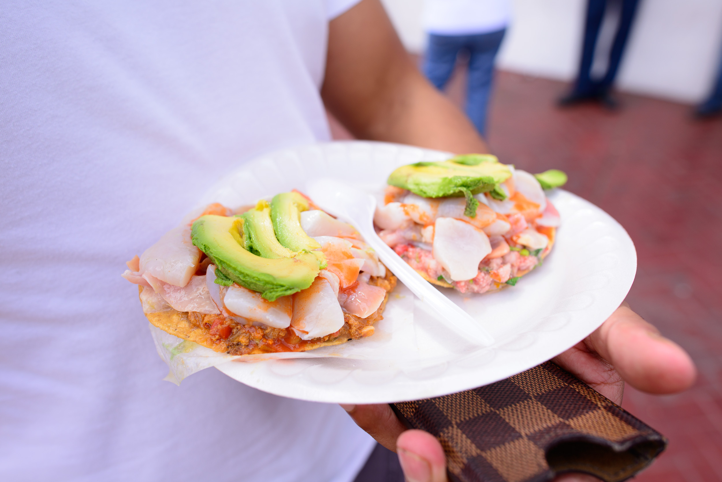 Tostadas de ceviche (mackerel and sea urchin) topped with almeja