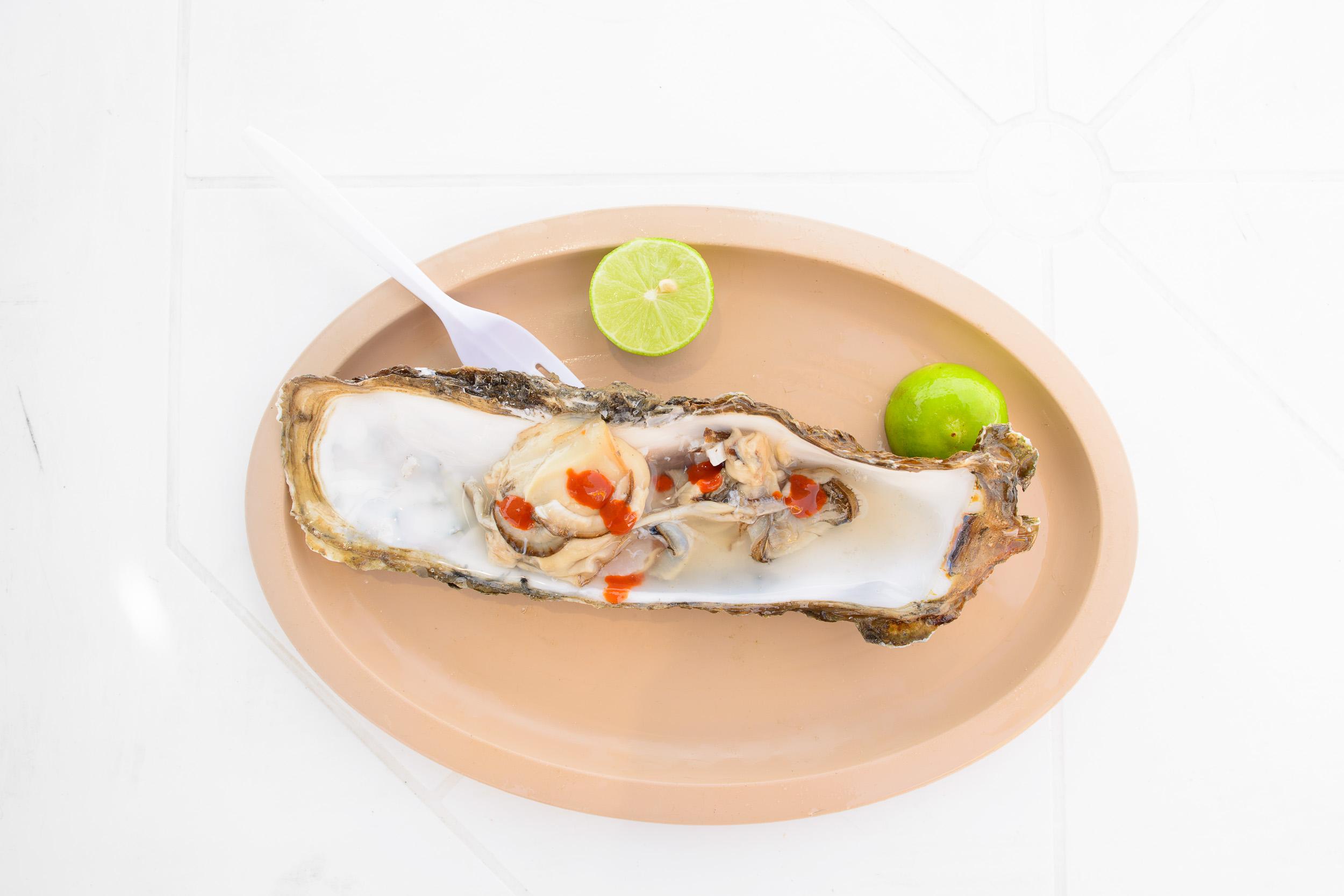 Ostiones huarache with salsa huichol, and lime