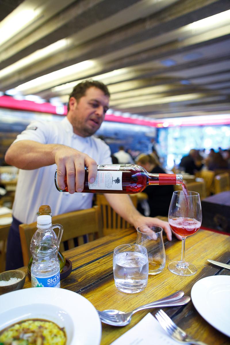 Chef Jair Téllez pours a glass of rosé from Baja California