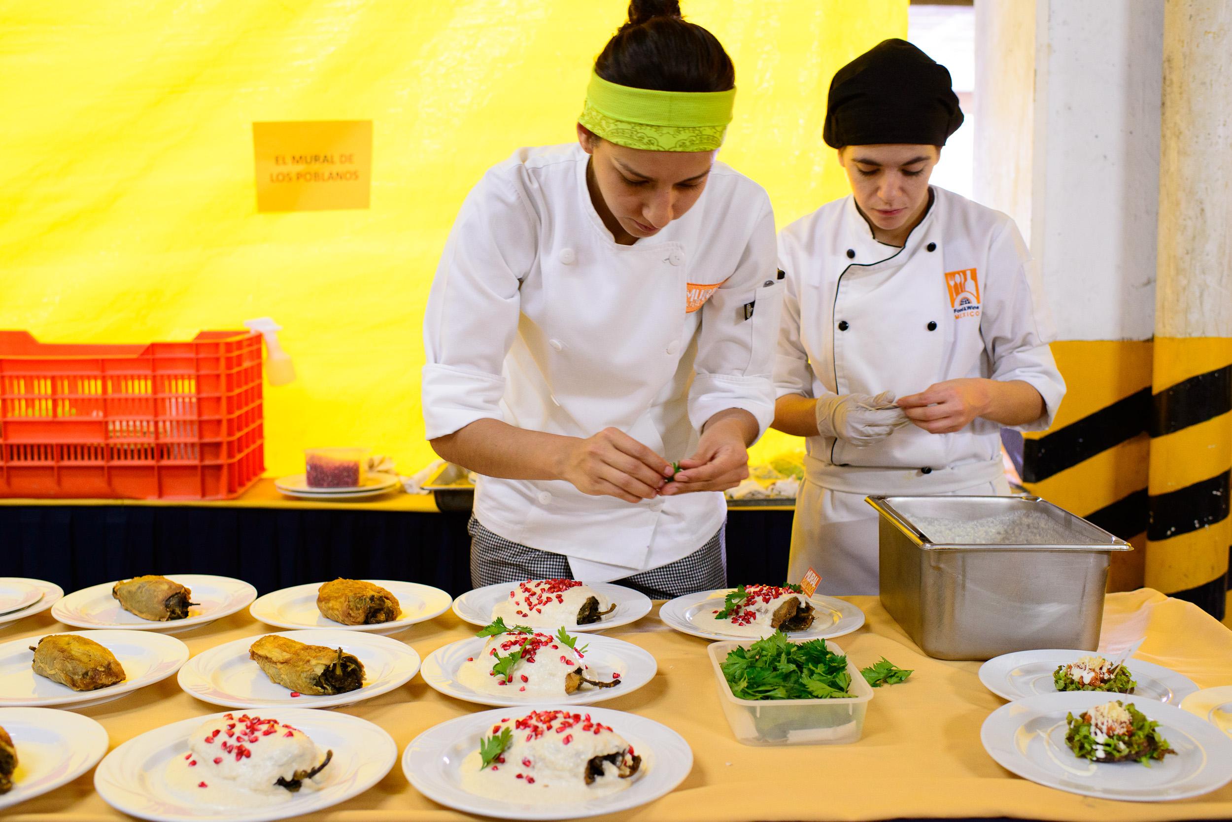 Chef Liz Galicia and assistant of El Mural de los Poblanos plati