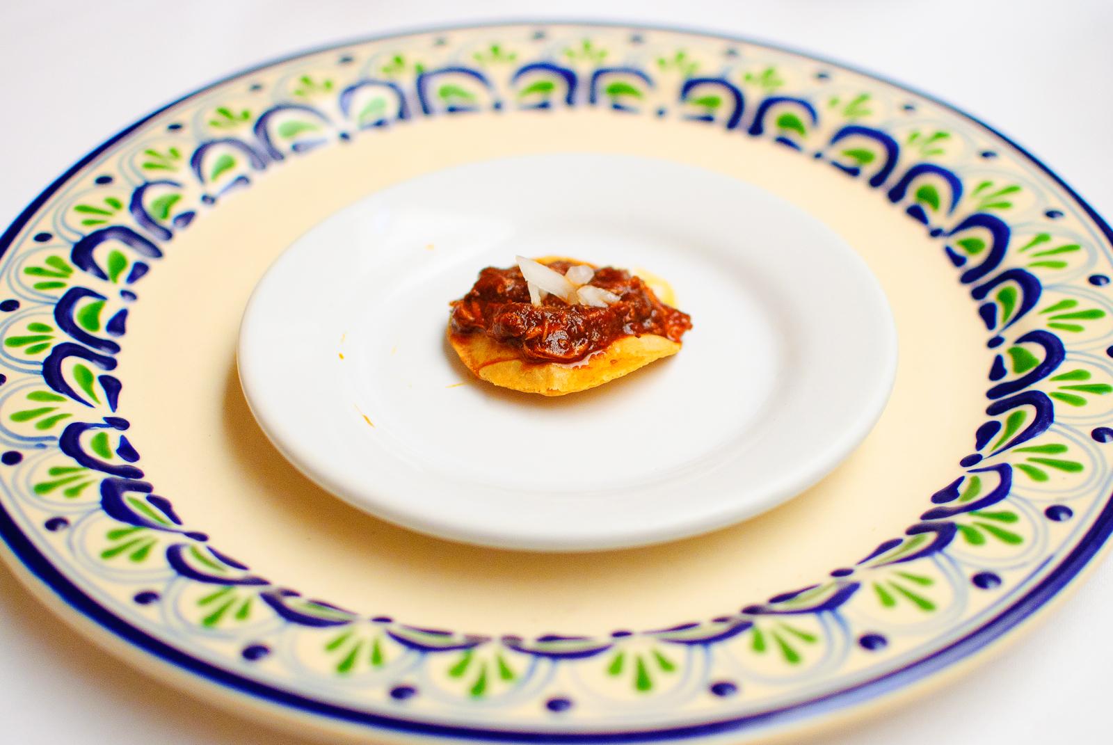 Tostadita de tinga (small stewed lamb tostada)