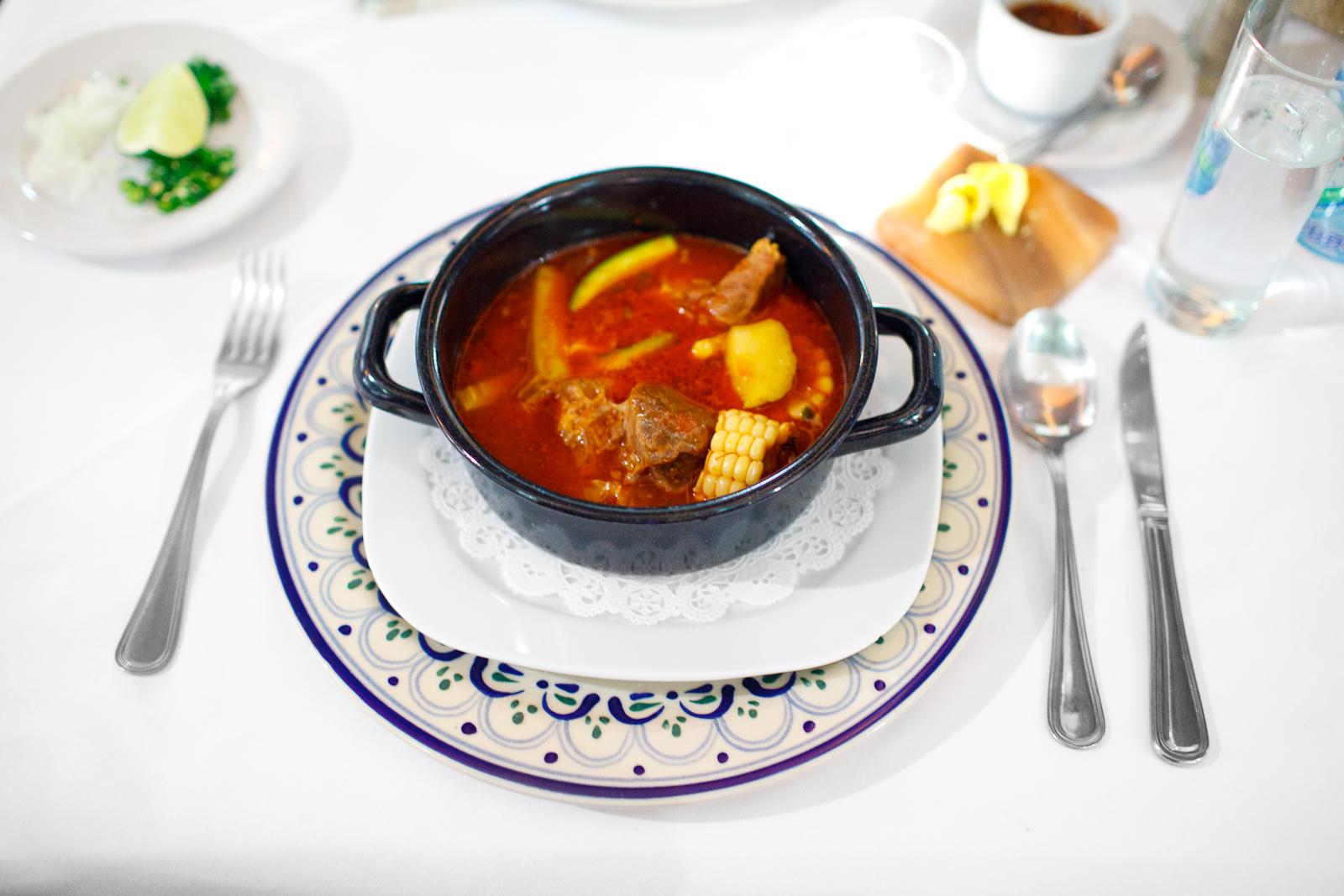 Mole de olla - Trozos de chambarete cocinados en caldillo de jitomate con elotes, calabazas, xoconostle, ejotes, y el grado exacto de picor (Pueblan beef tomato stew with corn, squash, opuntia,beans)