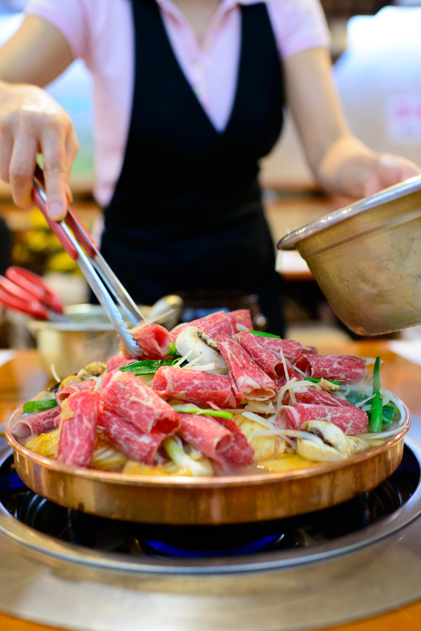 Preparing Halabuhji kimchi bulgogi - thinly sliced boneless rib