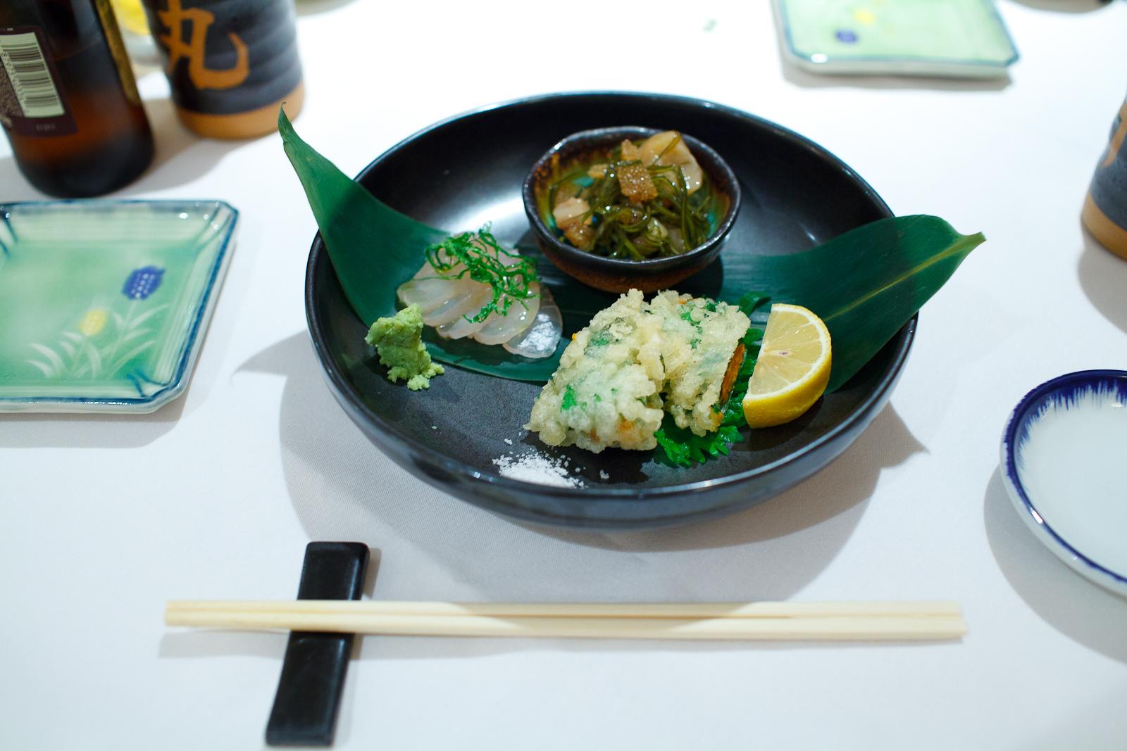 Kelp cured medai, squid, herring roe, seaweed marinated with soy sauce, sea urchin wrapped in shiso tempura ($12)
