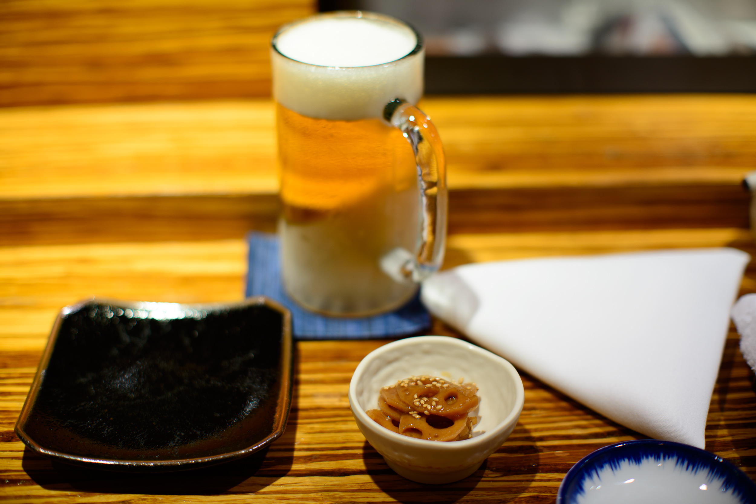 1st Course: Marinated lotus root, Sapporo draft beer