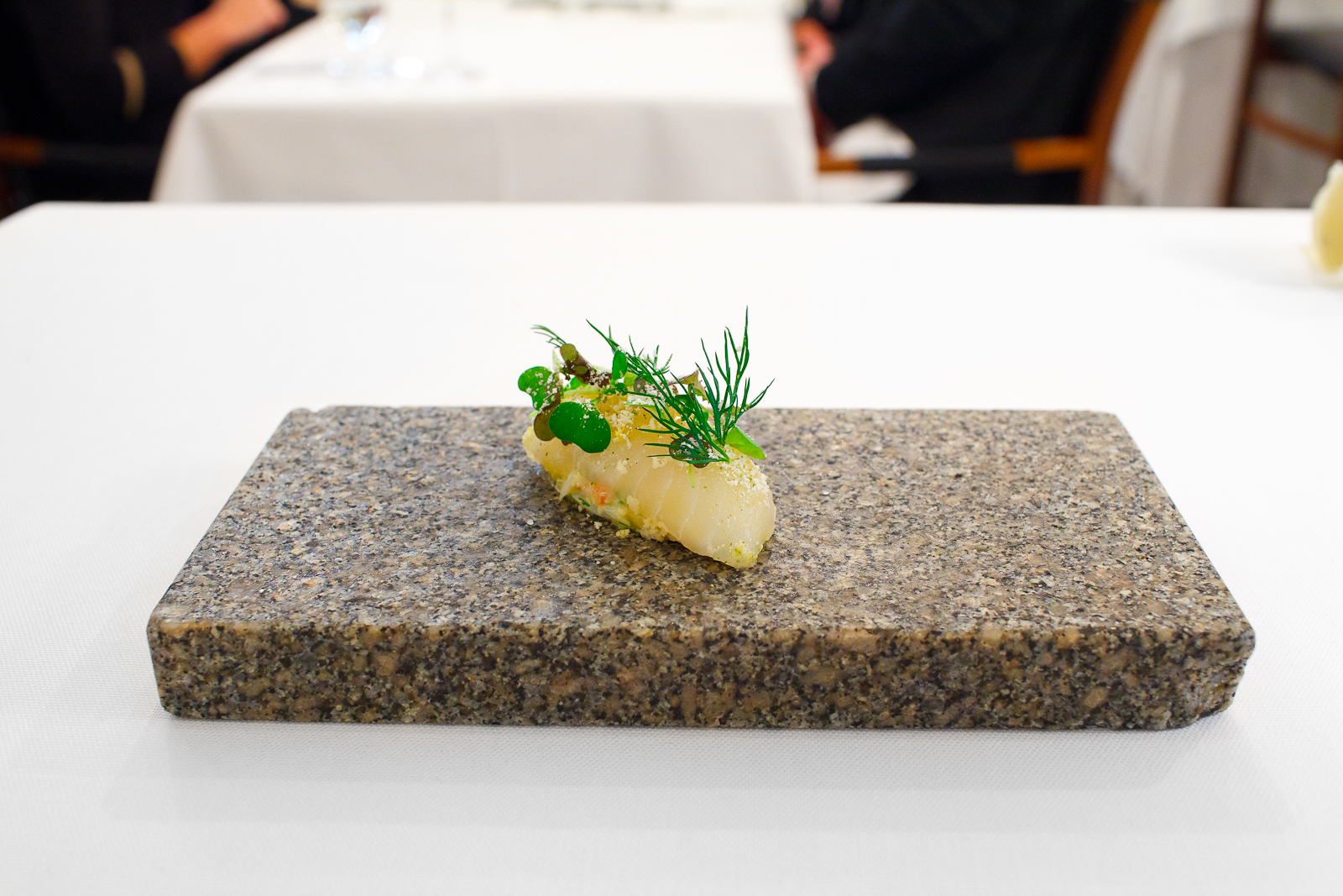 Amuse Bouche_ 12-day aged halibut with duck eggs from Blaxsta and fresh king crab from Norway, with autumn herbs flavored with green tea and lemon.jpg