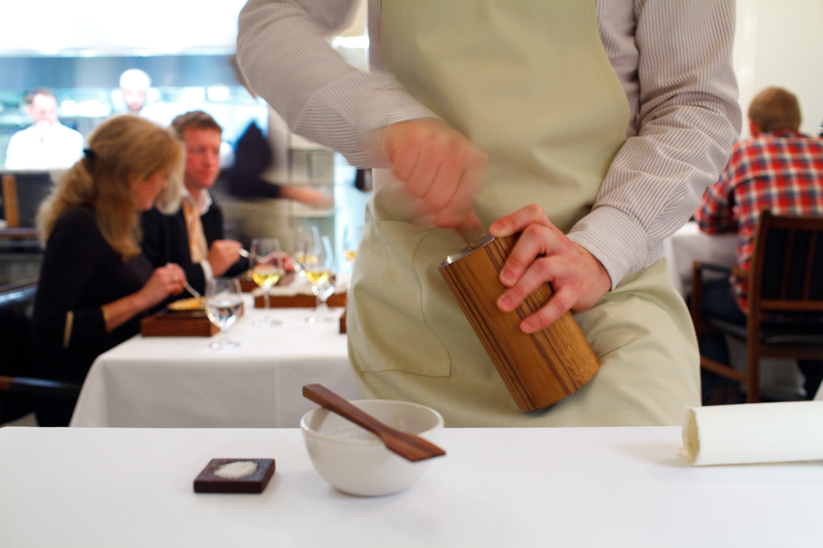 Churning butter tableside in a pool of its own buttermilk