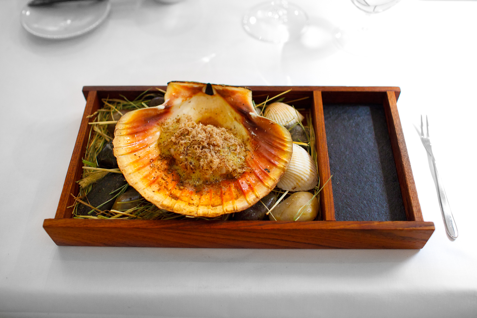 3rd Course: Scallop from Trondheim, Norway in two servings. First, cooked over open fire in its shell with lemon sabayon, truffle, and natural juices.