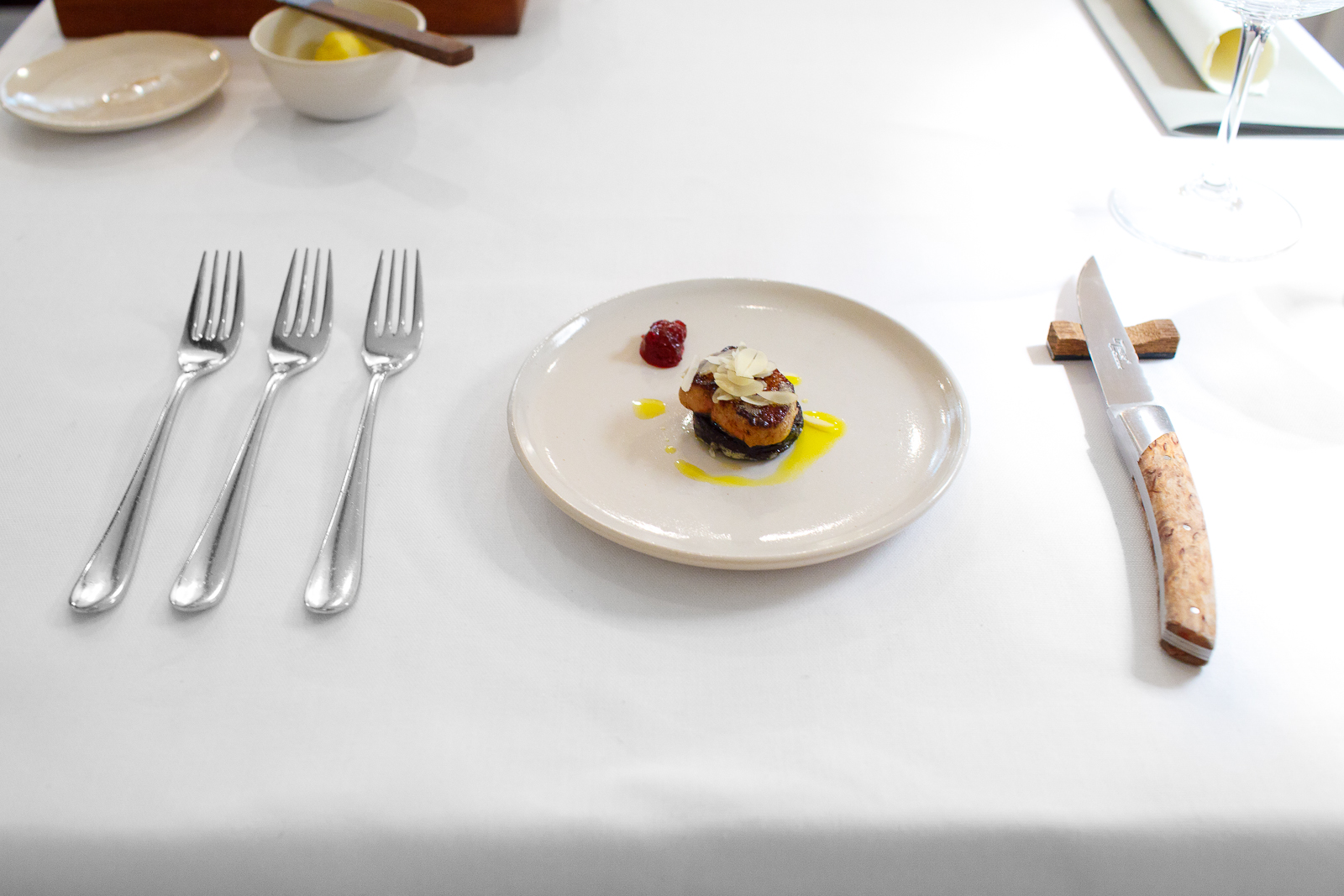 6th Course: First, the blood of the cow with pan-fried natural foie gras, sprouted almonds and preserved lingonberries.