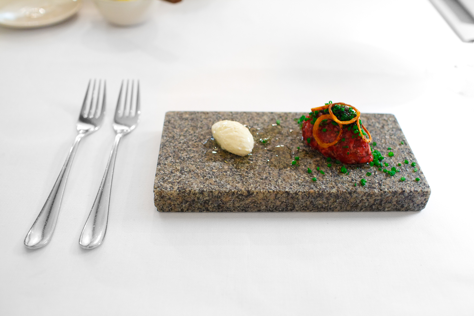6th Course: Second, a coal-flamed tartar of the prime rib flavored with tallow and ash, served with farmed caviar, sour cream, and cold-smoked eel from Mälaren