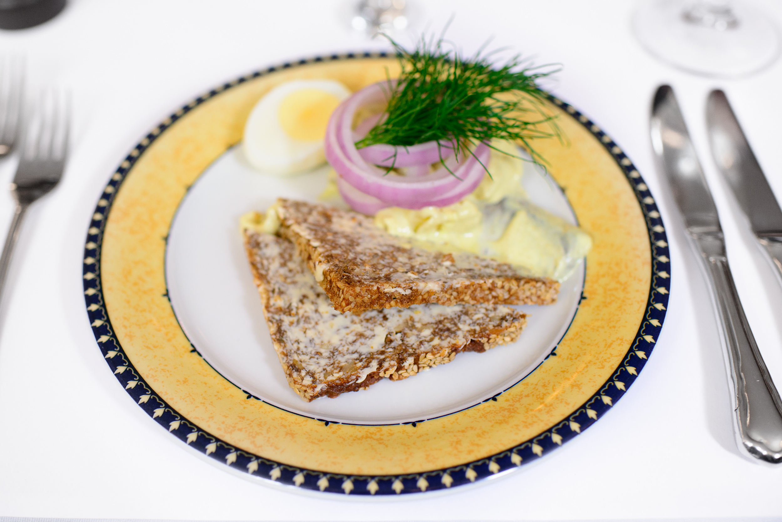 Curry-spiced herring of the house, served with egg