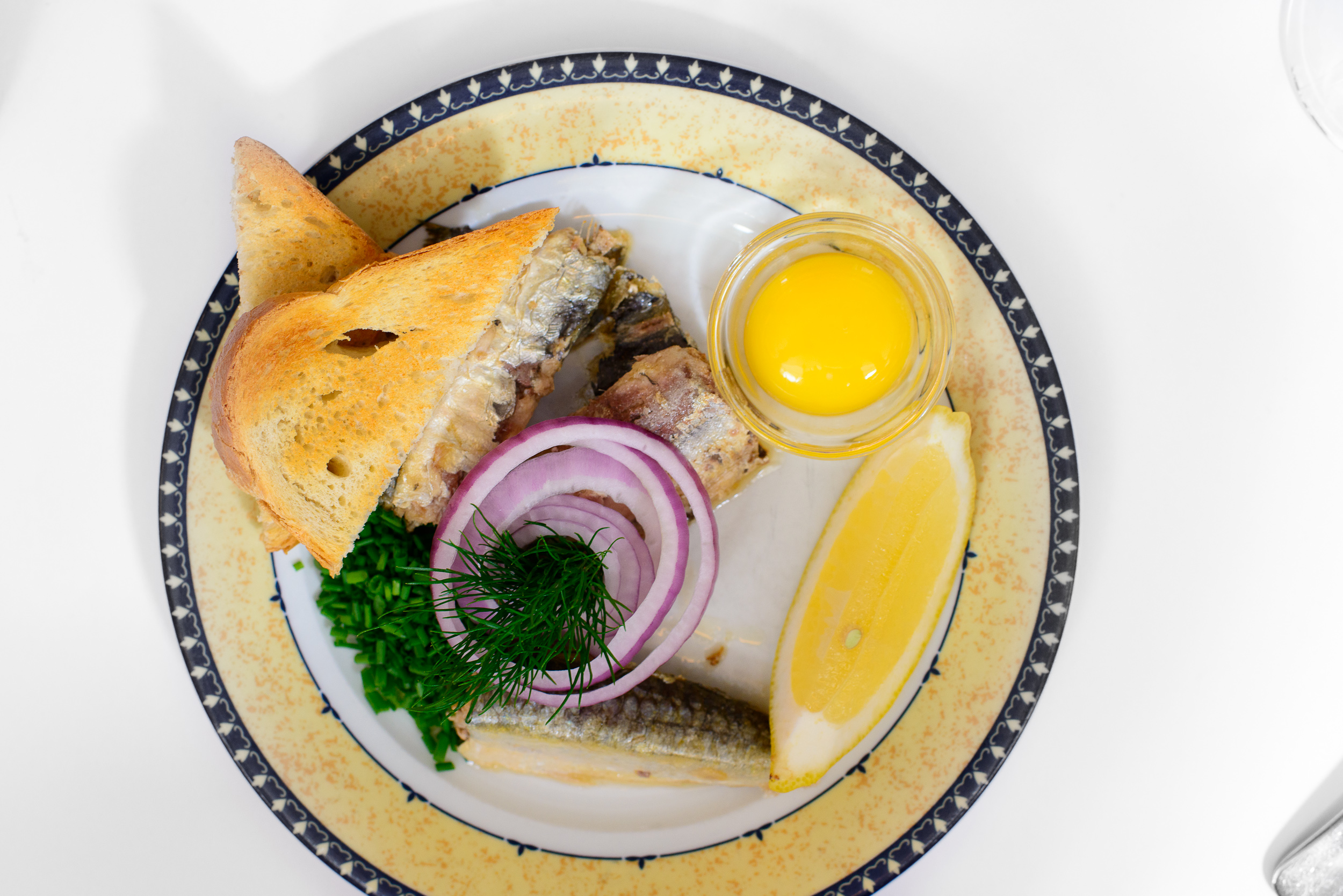 Sardines, raw egg yolk, onions and toast