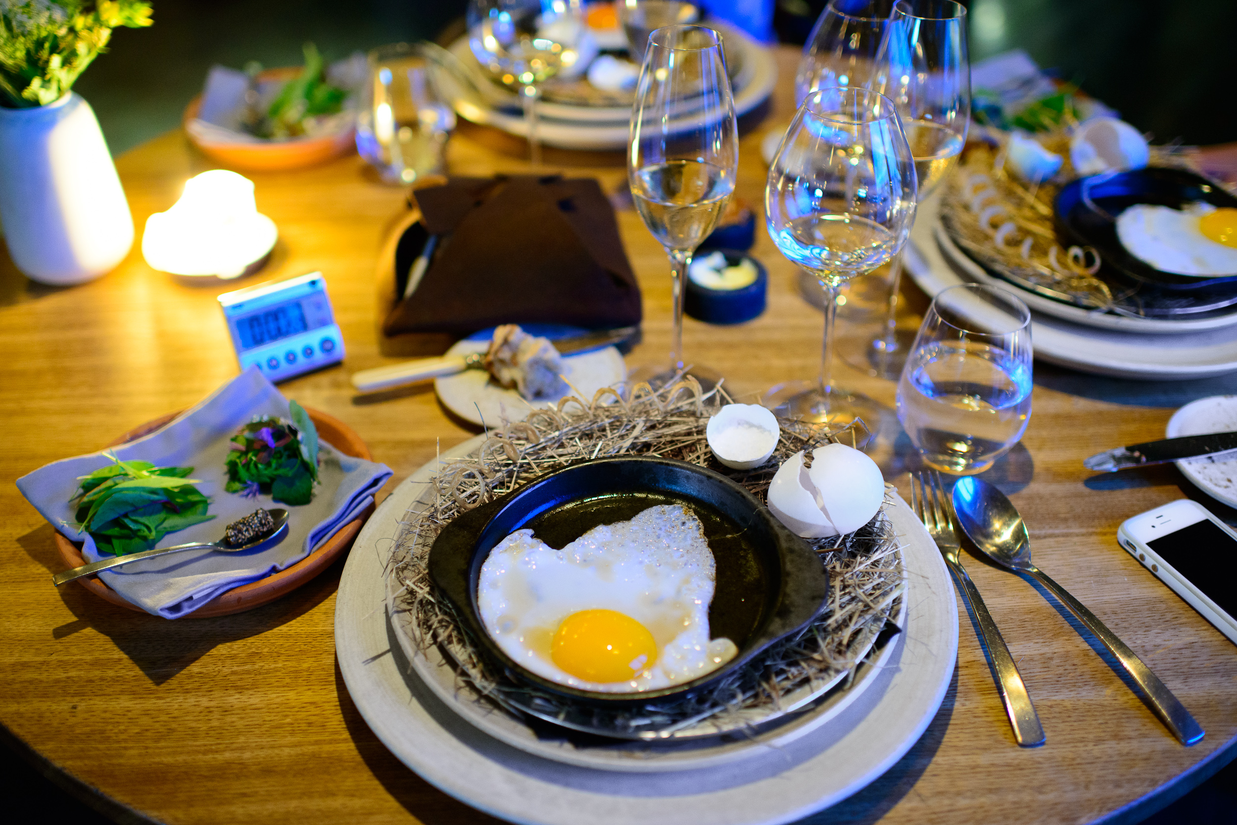 26th Course: Egg yolk and herbs - duck egg frying at the table