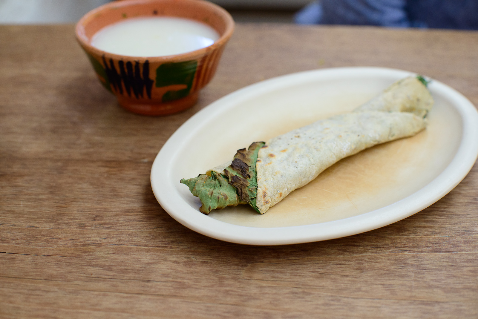 """De eso"" - Hoja santa and quesillo wrapped in a corn tortilla"