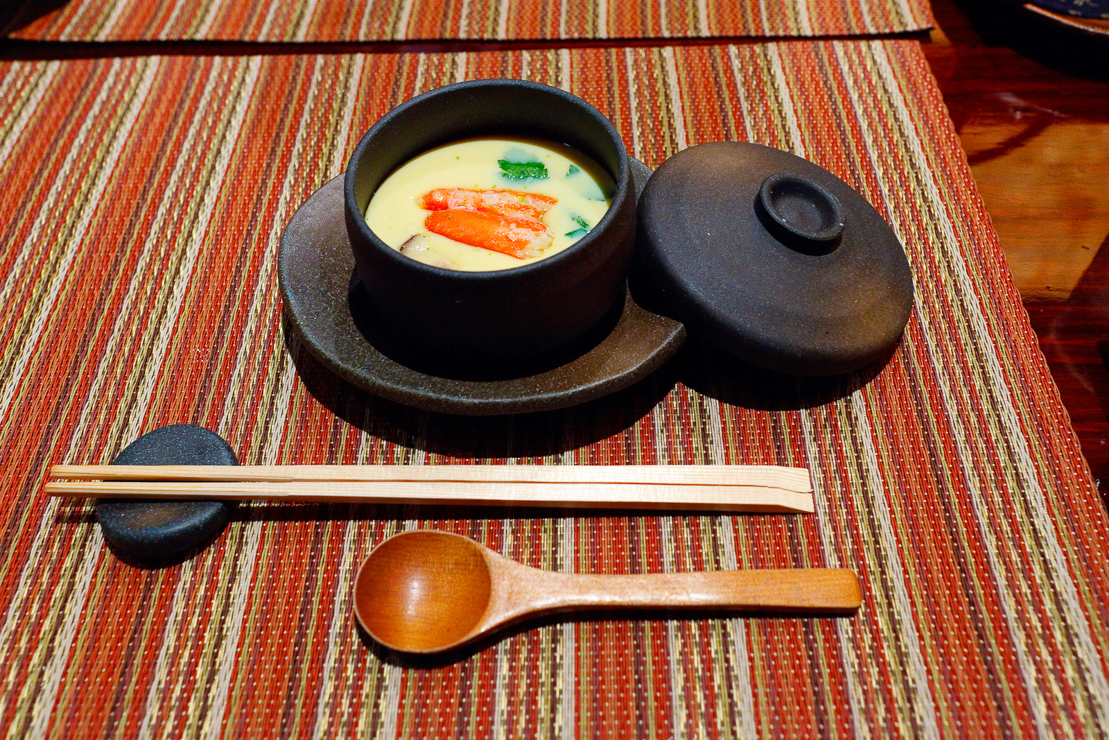 Chawanmushi, steamed egg custard cup with seafood, shrimp, crab, mochi, and vegetables ($10)