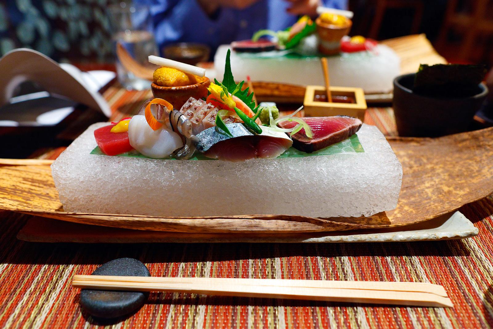 Assorted sashimi - Bonito seared with straw, marinated mackerel, Tasmanian salmon trout, kibinago (baby herring), Japanese snapper, sea urchin, fresh Hokkaido octopus, lean tuna