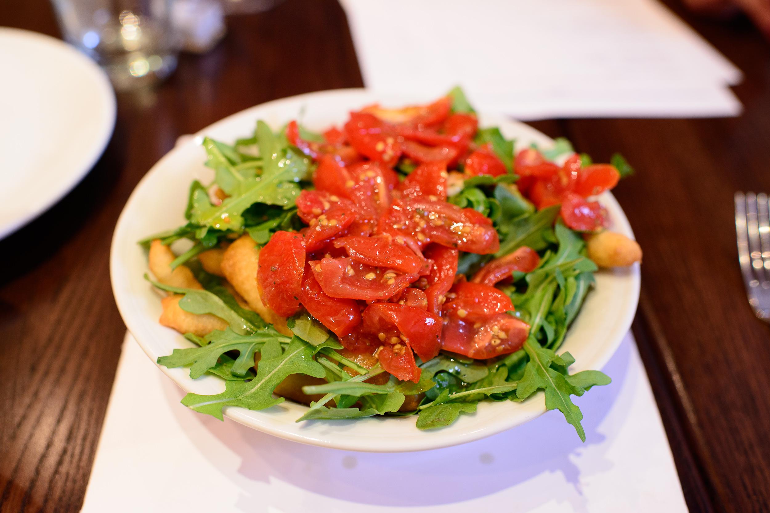 Angioletti - Baby arugula, grape tomatoes, deep-fried dough, bal
