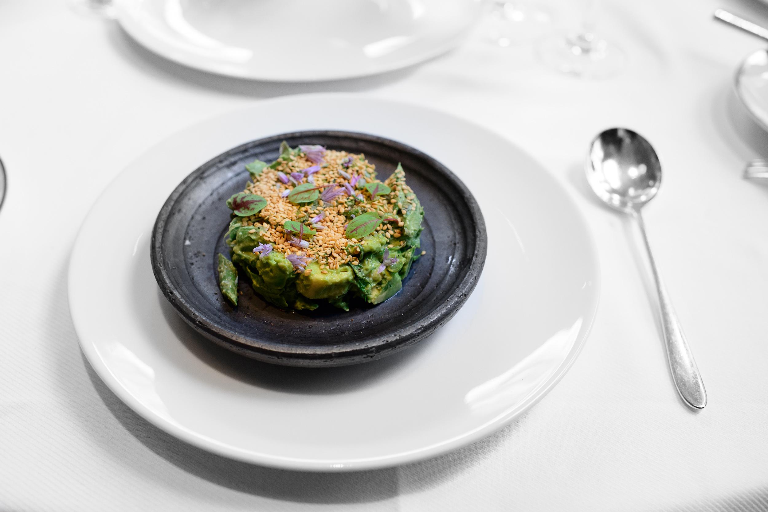 Green asparagus and avocado salad, sorrel dressing and sesame