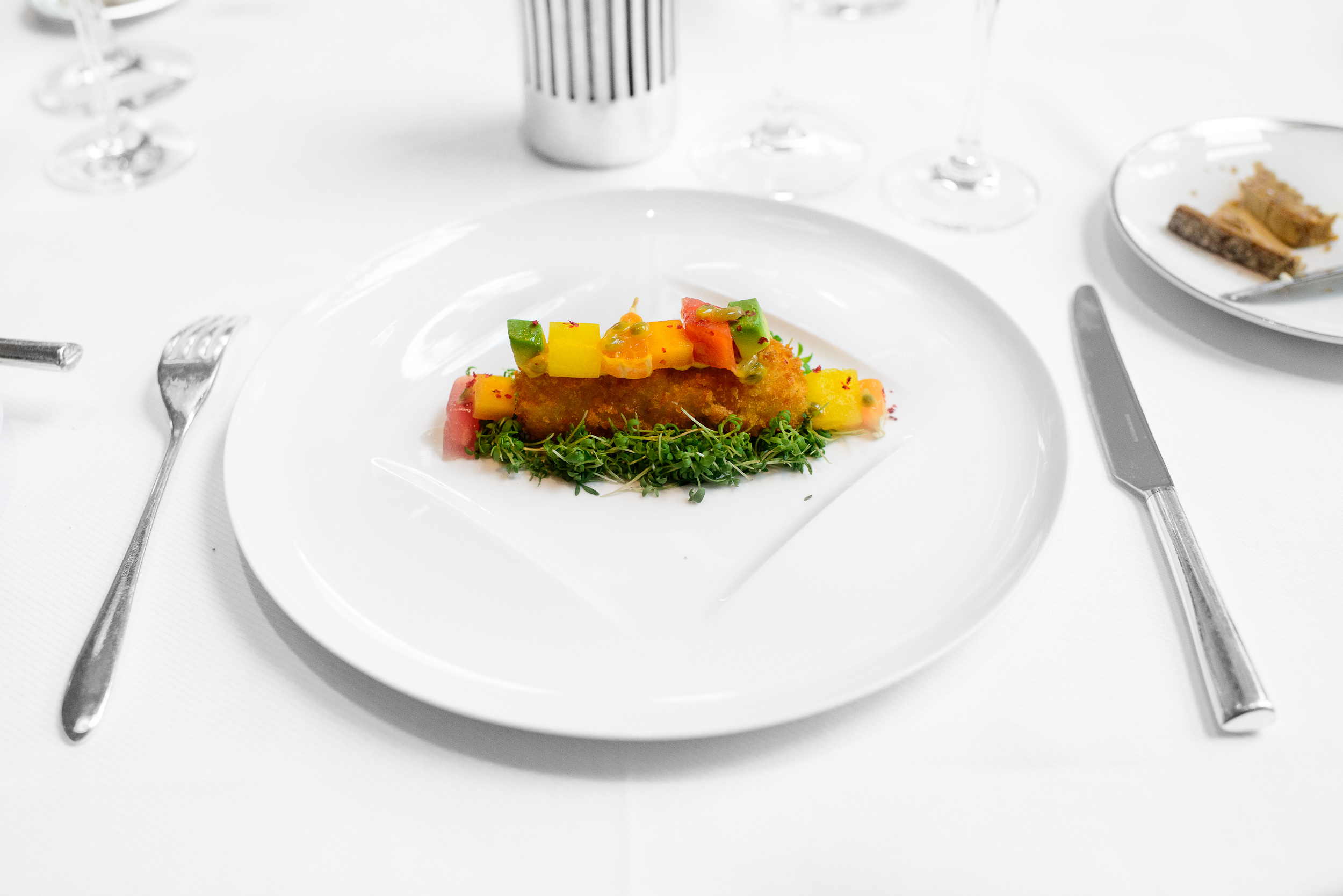 Crispy crab, pink peppercorn mustard, and exotic fruits