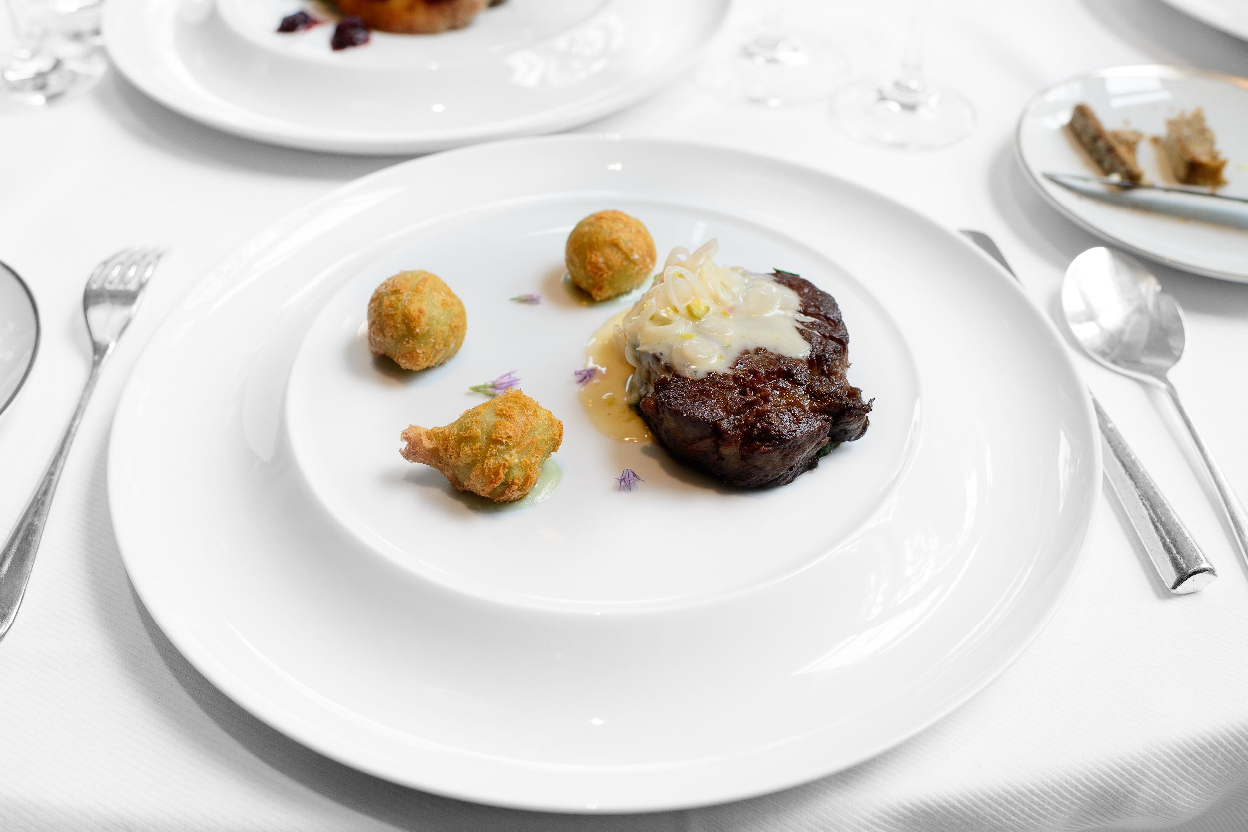 Caramelized wagyu beef, gorgonzola puffs, pickled ramp fondue