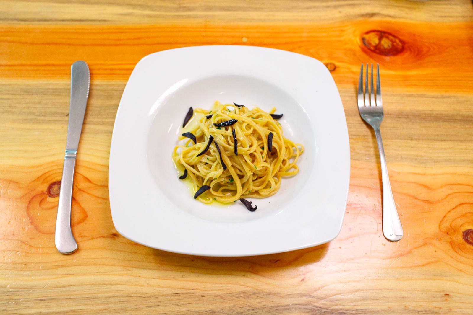 Chitarra square spaghetti, sea urchin, black garlic, parsley ($15)