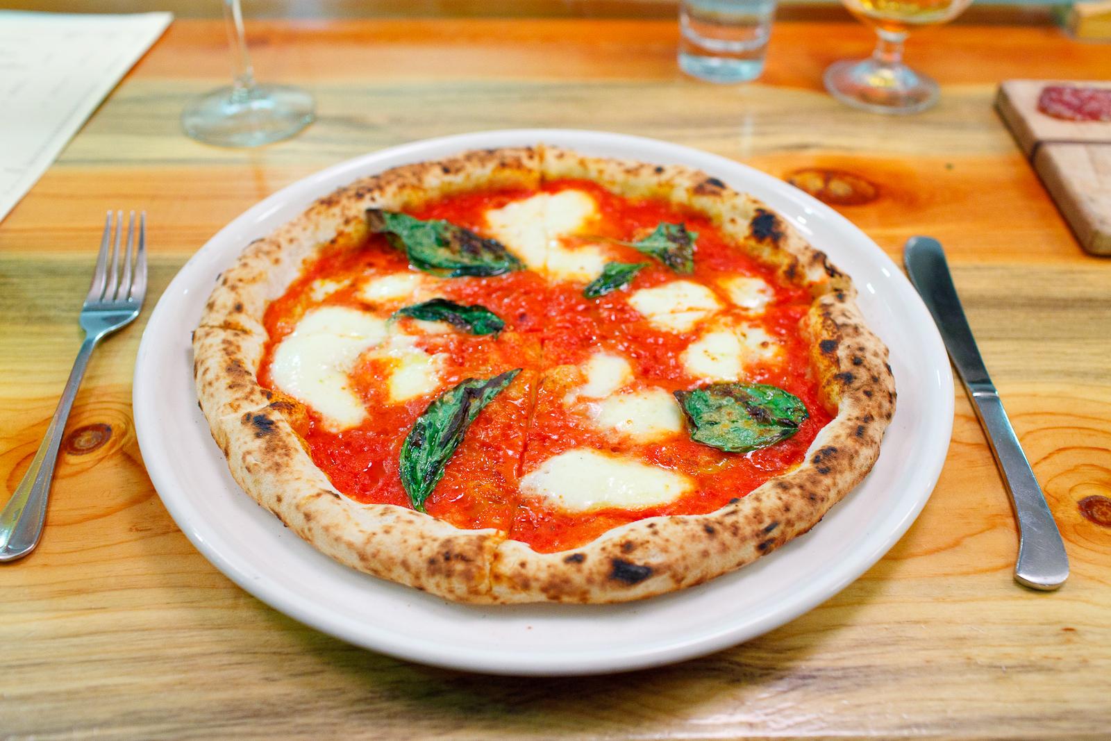 Pizza daisy - tomato sauce, mozzarella, basil, olive oil ($12)